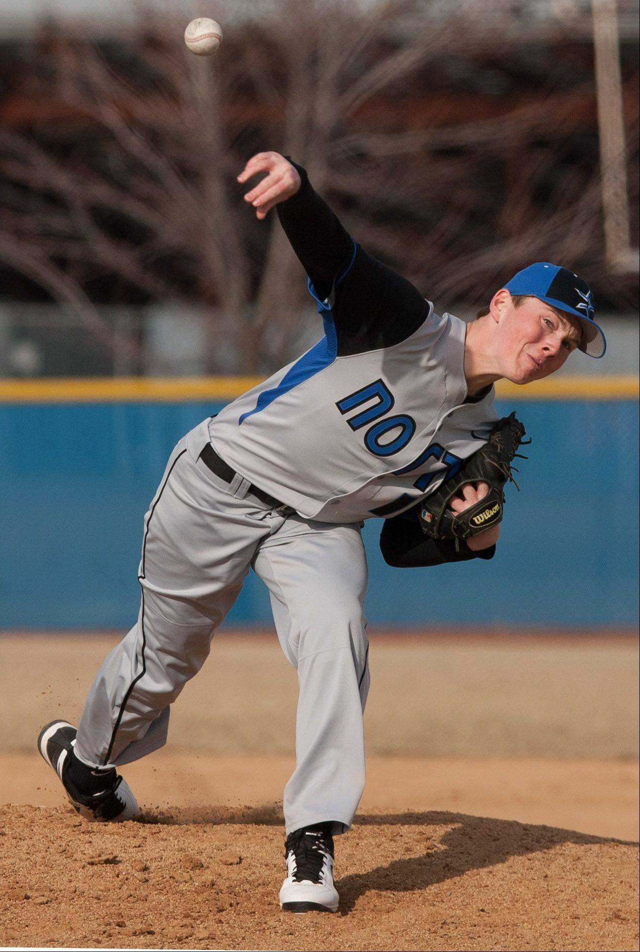 St. Charles North pitcher Sawyer Chambers delivers a pitch against Neuqua Valley, during boys baseball action in Naperville.