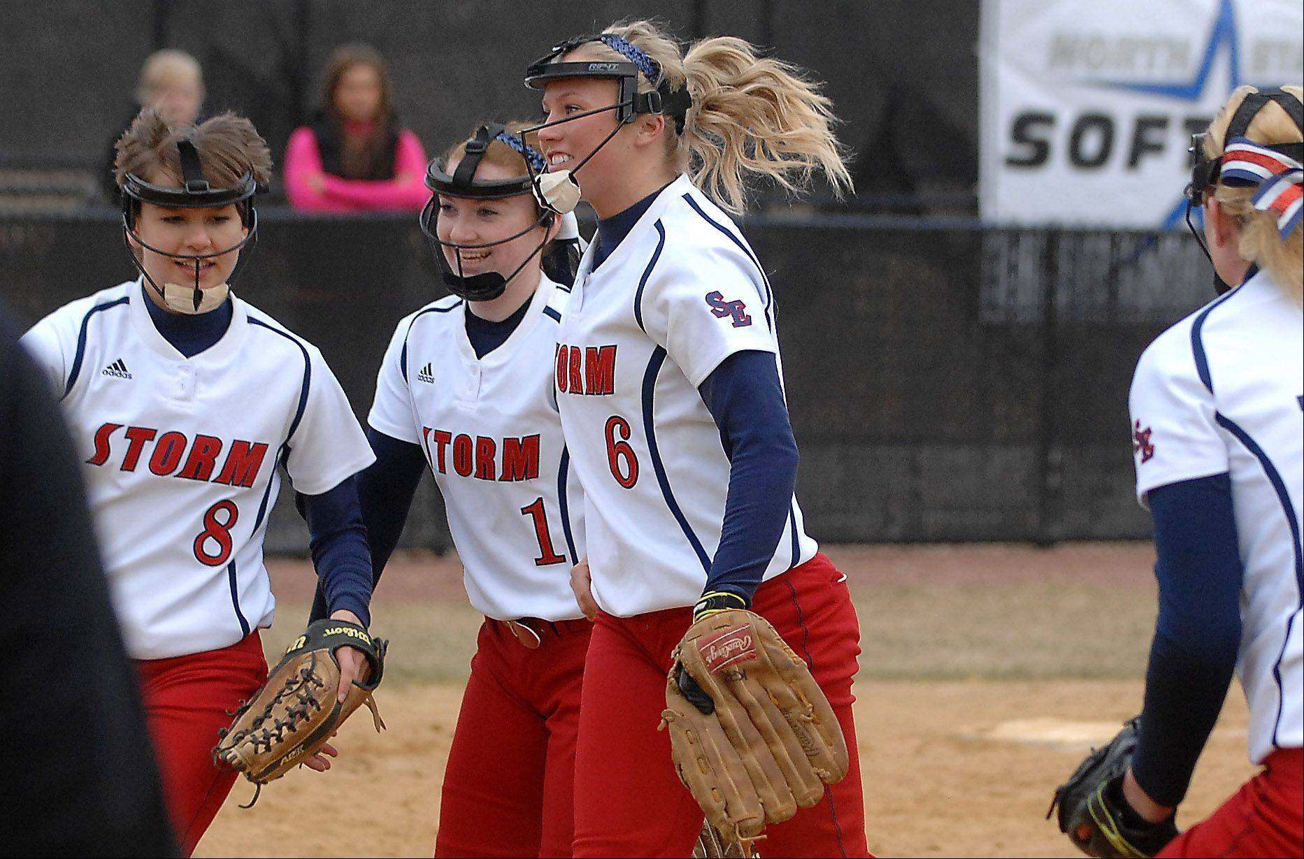 South Elgin's Victoria Watt (8), Paige Allen (1) and Kara Rodriguez (6) are all smiles after the Storm recorded the final out to beat St. Charles North during Friday's game in St. Charles.