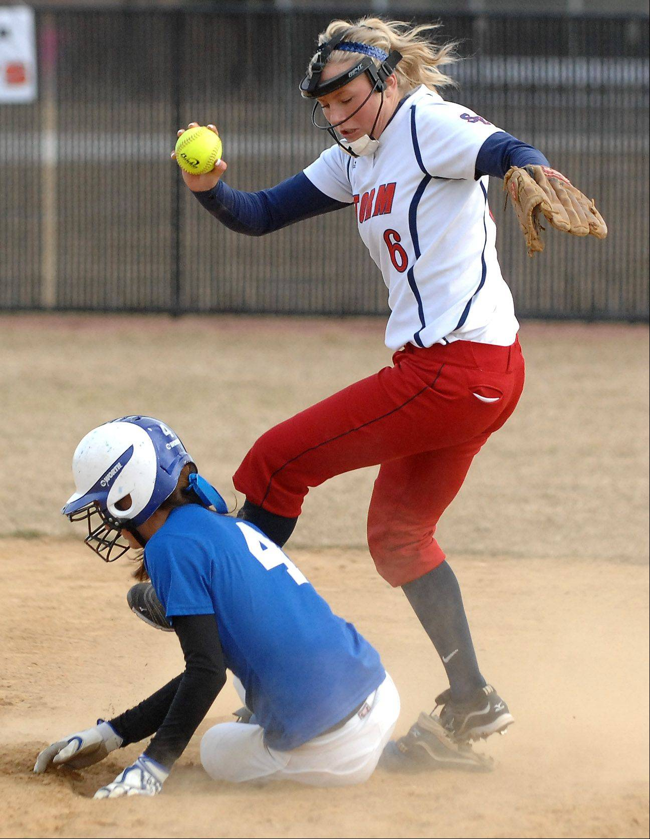 St. Charles North's Kaitlyn Waslawski bears down and breaks up a chance for a double play by South Elgin's Kara Rodriguez during Friday's game in St. Charles.