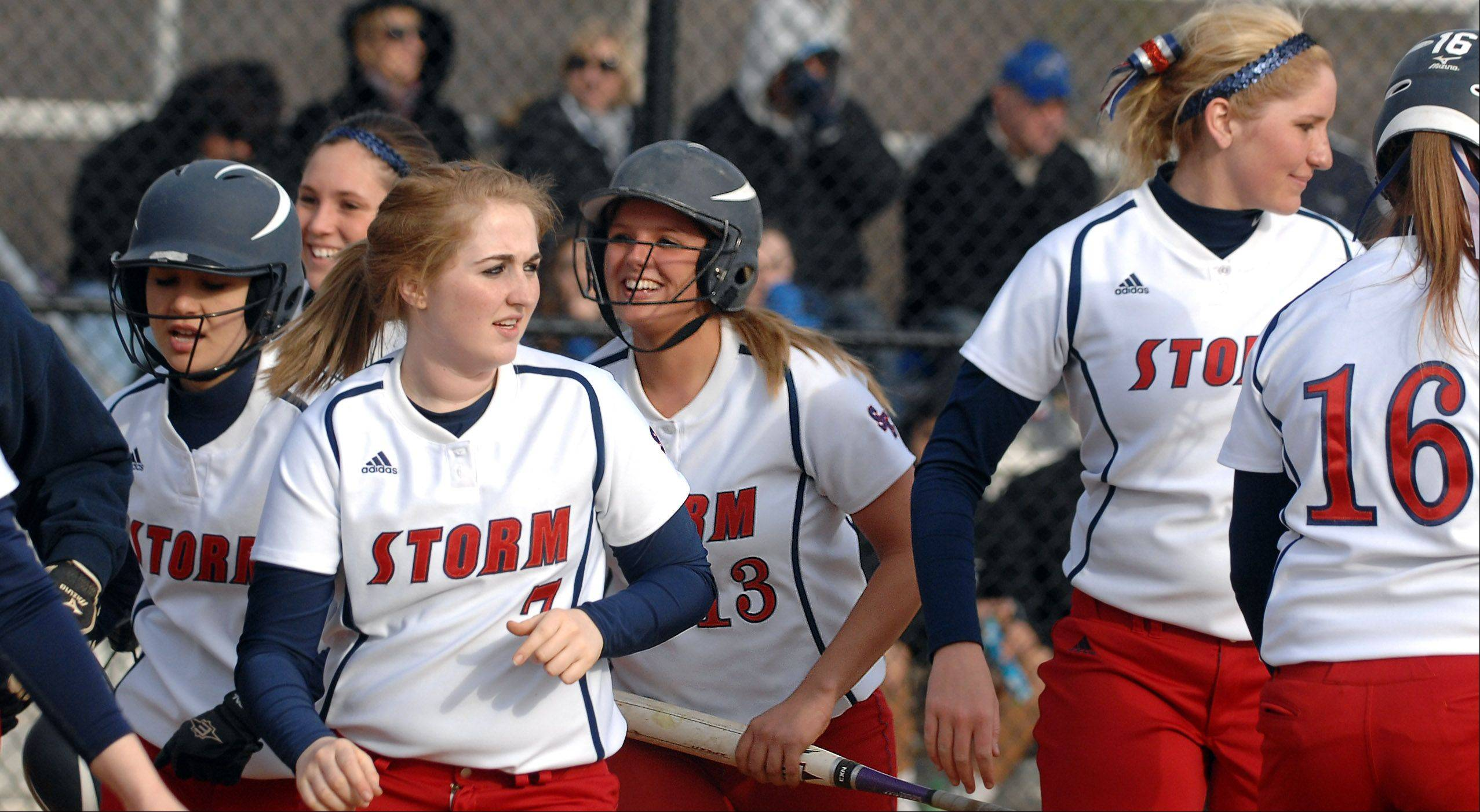South Elgin players, including Alyssa Buddle (13), head back to the dugout after her 3-run homer against St. Charles North during Friday's game in St. Charles.