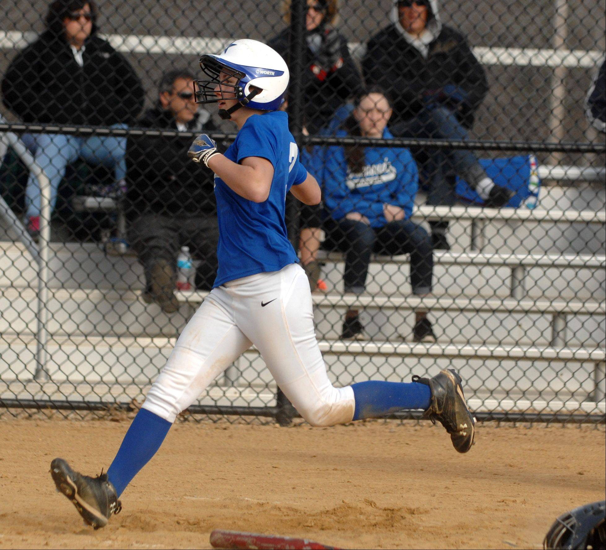 St. Charles North's Andrea Beal crosses the plate to score the team's only run against South Elgin during Friday's game in St. Charles.