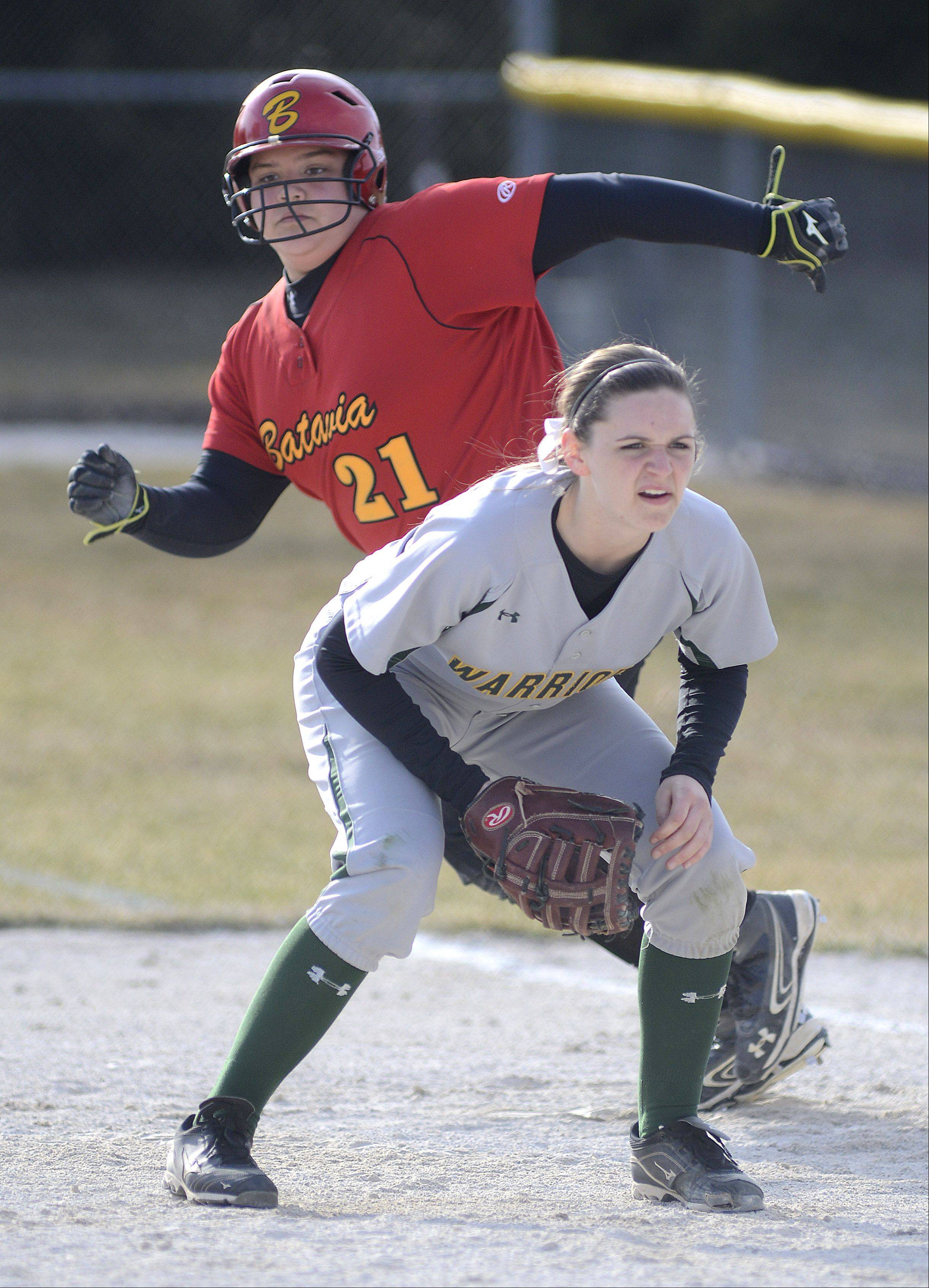 Batavia's Selena Kweder preps to steal second base while leaving first and Waubonsie Valley's Jordan Kurth in the second inning on Friday, April 5.