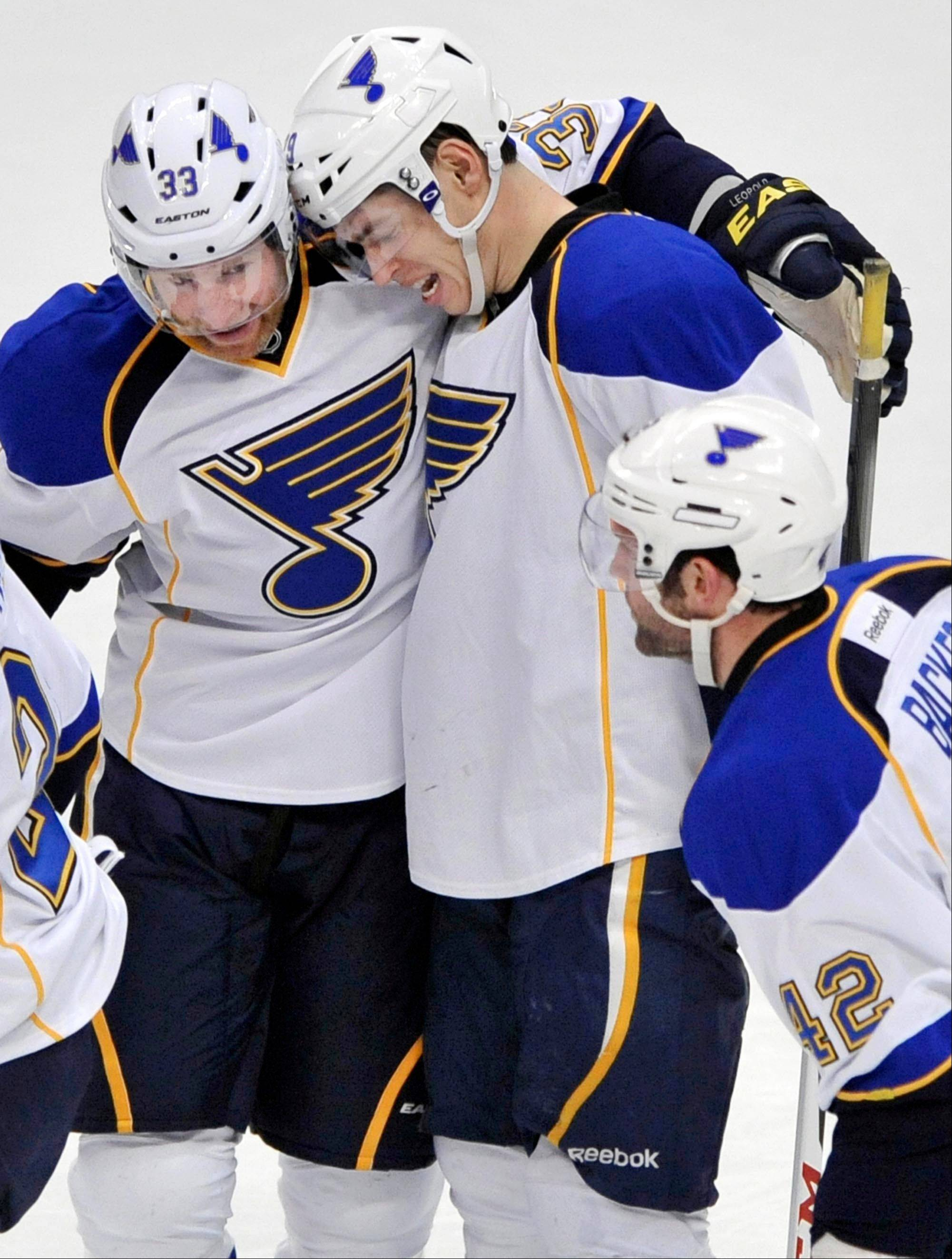 St. Louis Blues' Adam Cracknell, right, celebrates with teammate Jordan Leopold, left, after scoring against the Chicago Blackhawks during the first period of an NHL hockey game in Chicago, Thursday, April, 4, 2013.