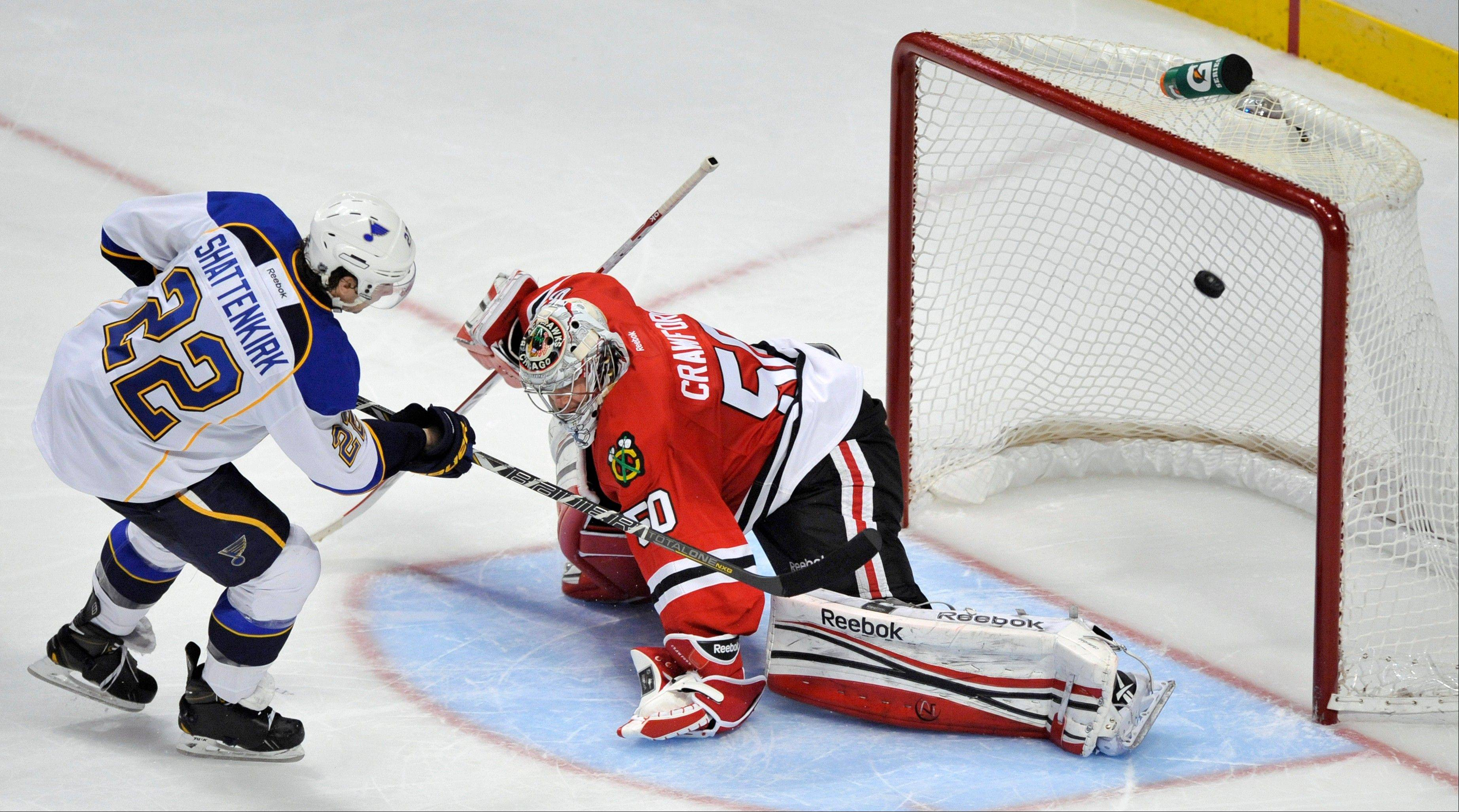 St. Louis Blues' Kevin Shattenkirk (22), scores against Chicago Blackhawks goalie Corey Crawford during a shootout in an NHL hockey game in Chicago, Thursday, April 4, 2013. St. Louis won 4-3.
