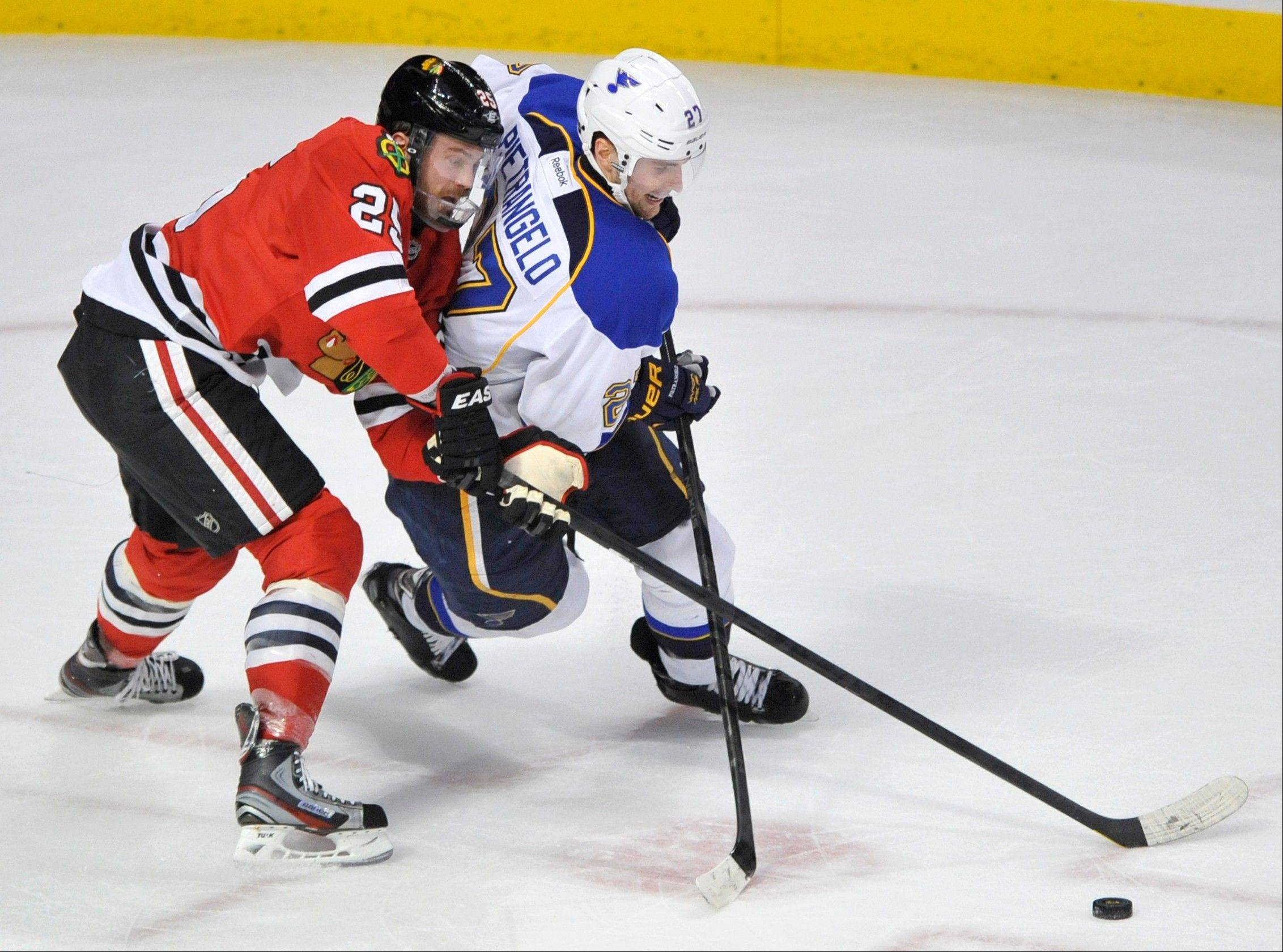 St. Louis Blues' Alex Pietrangelo, right, and Chicago Blackhawks' Viktor Stalberg, of Sweden, race for the puck during overtime in an NHL hockey game in Chicago, Thursday, April 4, 2013. St. Louis won 4-3 in a shootout.