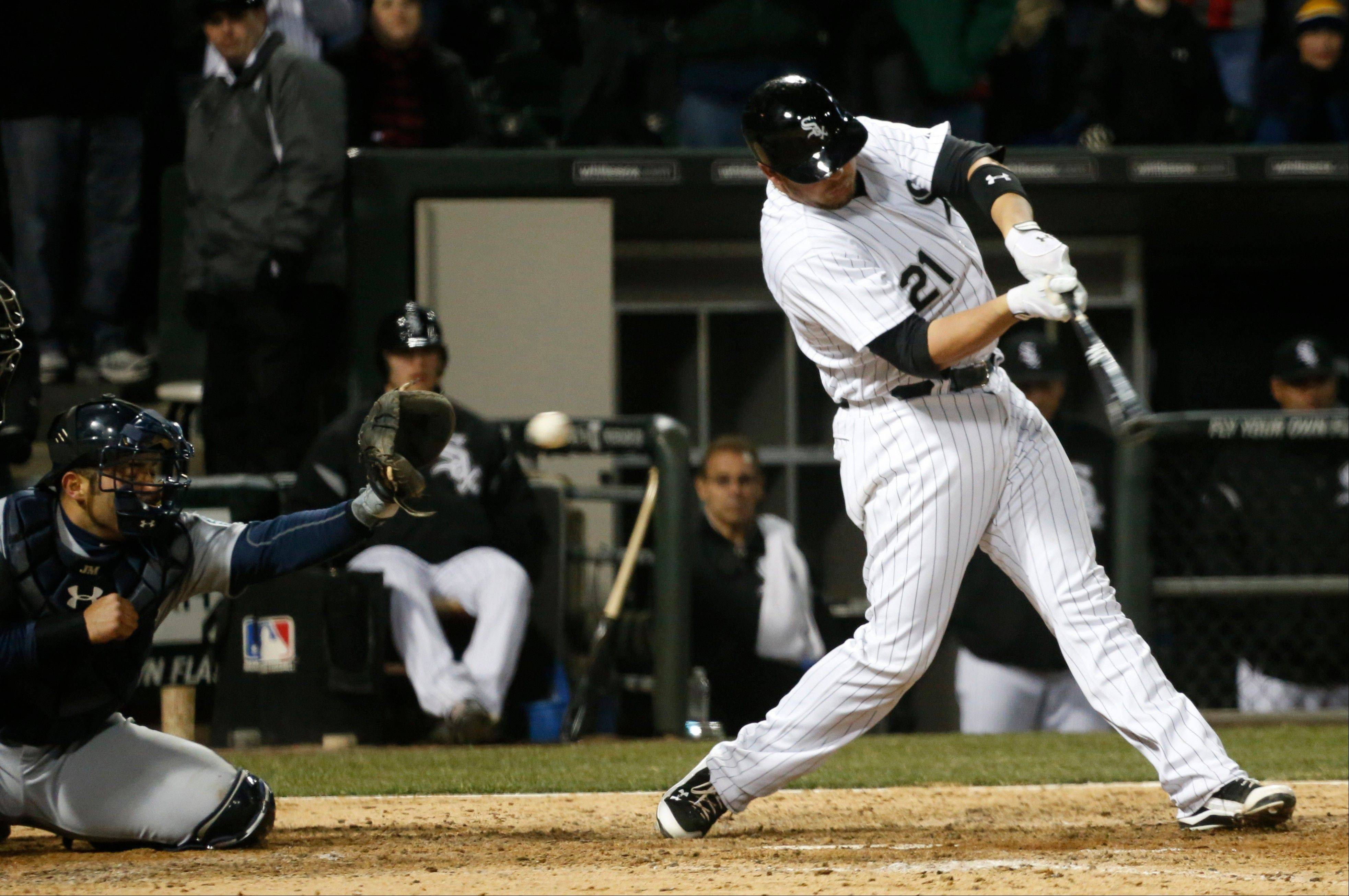 Tyler Flowers strikes out swinging with the bases loaded to end the White Sox' 8-7 loss to the Mariners on Friday night at U.S. Cellular Field.
