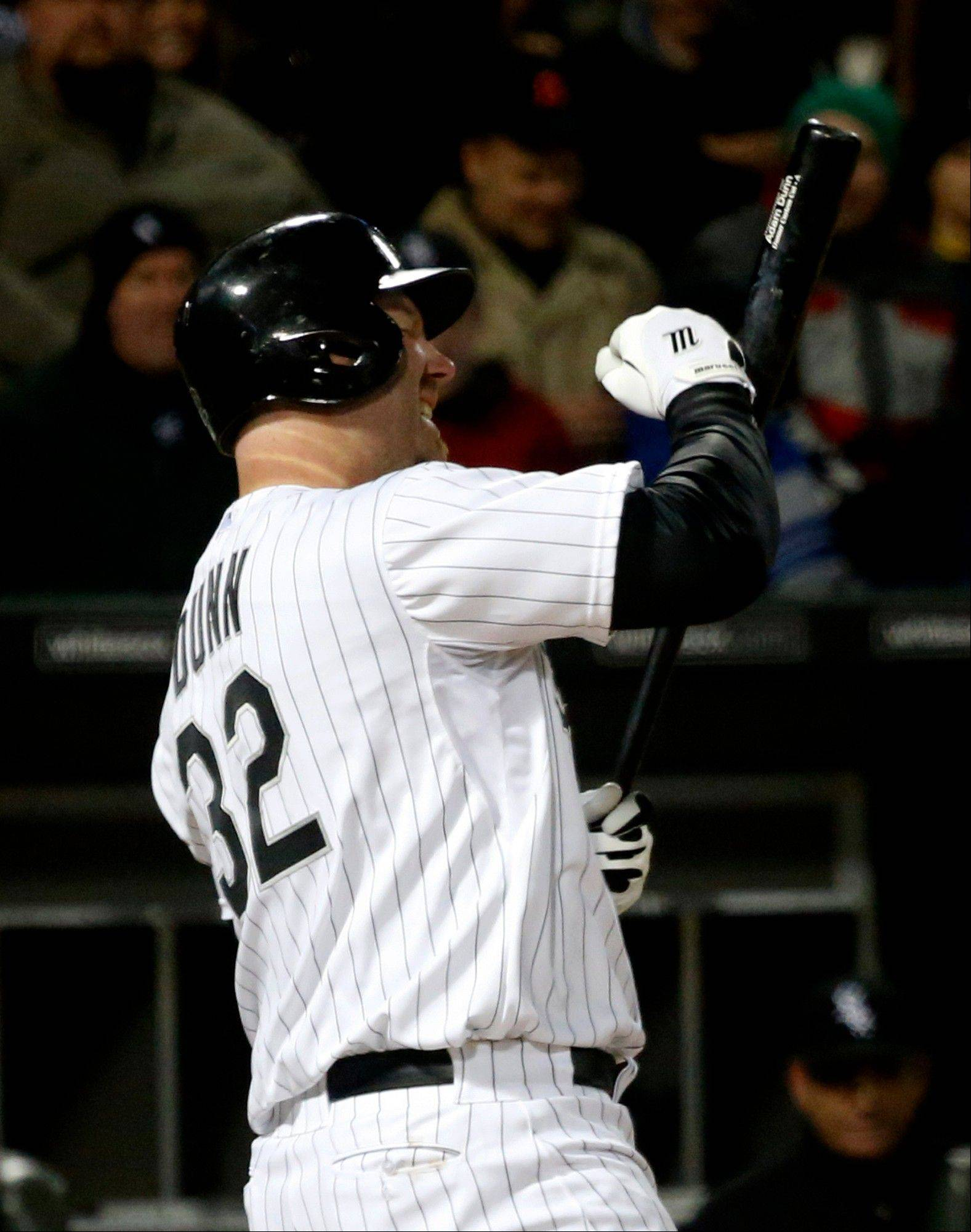 Chicago White Sox's Adam Dunn punches his bat after striking out against Seattle Mariners starting pitcher Blake Beavan during the fifth inning of a baseball game on Friday, April 5, 2013, in Chicago.