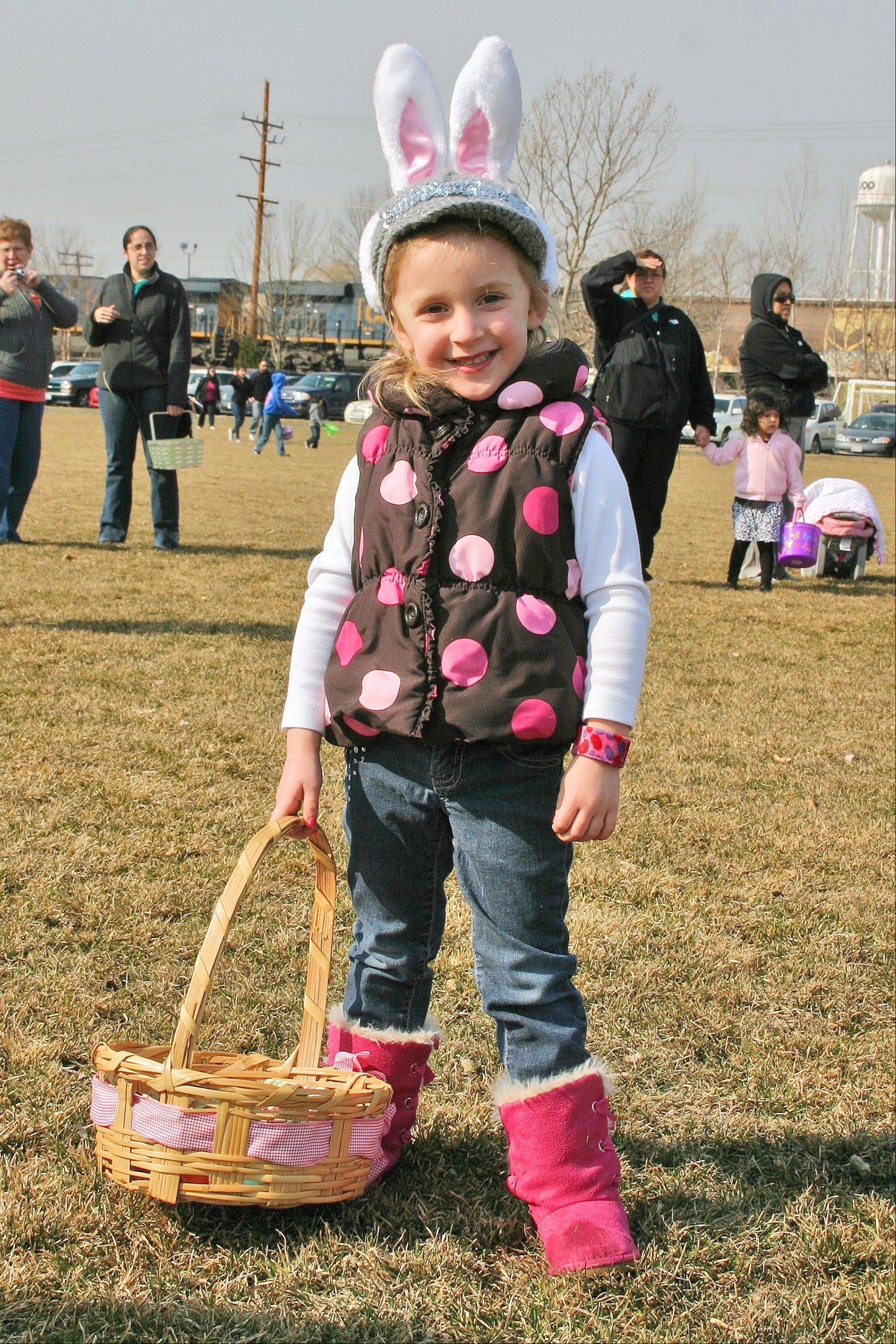 Madison Jakubowski, 4, collected a dozen eggs at the annual Des Plaines Park District free Easter egg hunt on Saturday, March 30, at Prairie Lake Park.