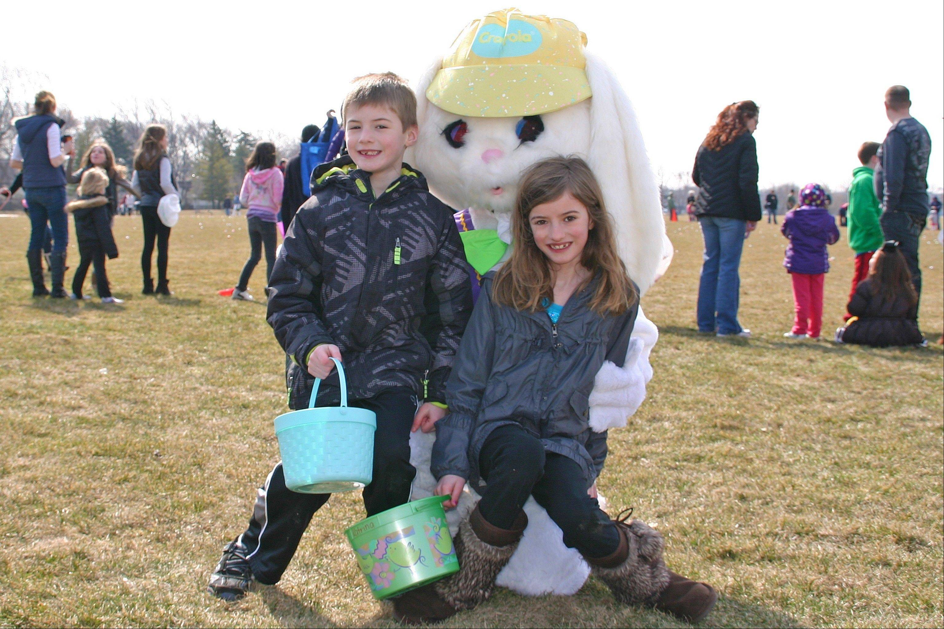 Ian and Katrina Miletic visit with the Easter Bunny at the annual Des Plaines Park District free Easter egg hunt Saturday, March 30, at Prairie Lake Park.