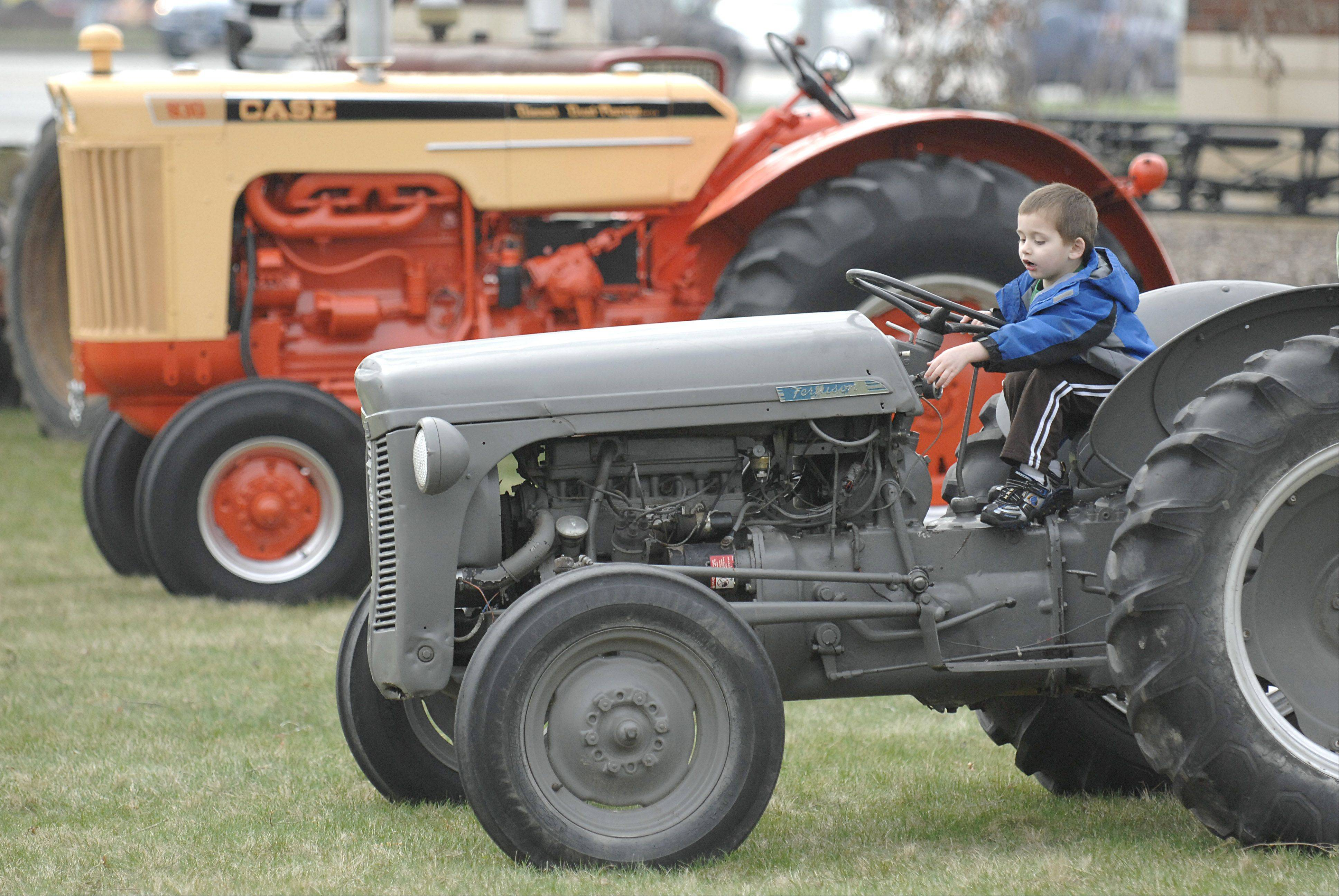 Kids can sit in the seat of an antique tractor, ride pedal tractors, see farm animals and more at the eighth annual Touch-A-Tractor at the Kane County Farm Bureau in St. Charles.