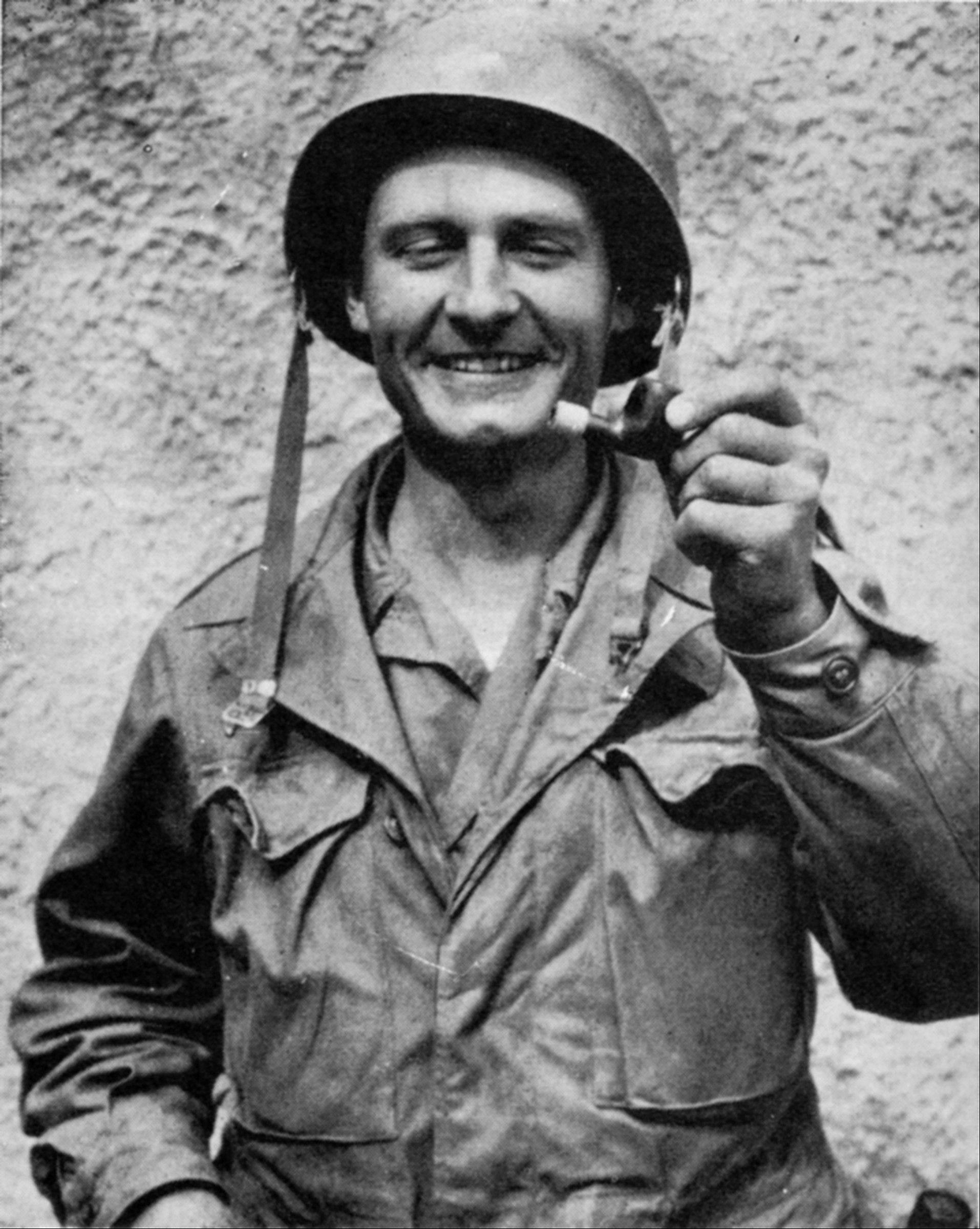 In this undated photo provided by the Catholic Diocese of Wichita, Father Emil Kapaun holds out a broken pipe. The plain-spoken, pipe-smoking chaplain is receiving the Medal of Honor posthumously for his �extraordinary heroism� while serving as an Army chaplain during the Korean War. He died in captivity in 1951 _ about six months after being taken prisoner. His fellow POWs lobbied for decades to have him receive the prestigious military honor and some of them will be at the White House to see his relatives accept the medal on his behalf on April 11, 2013.