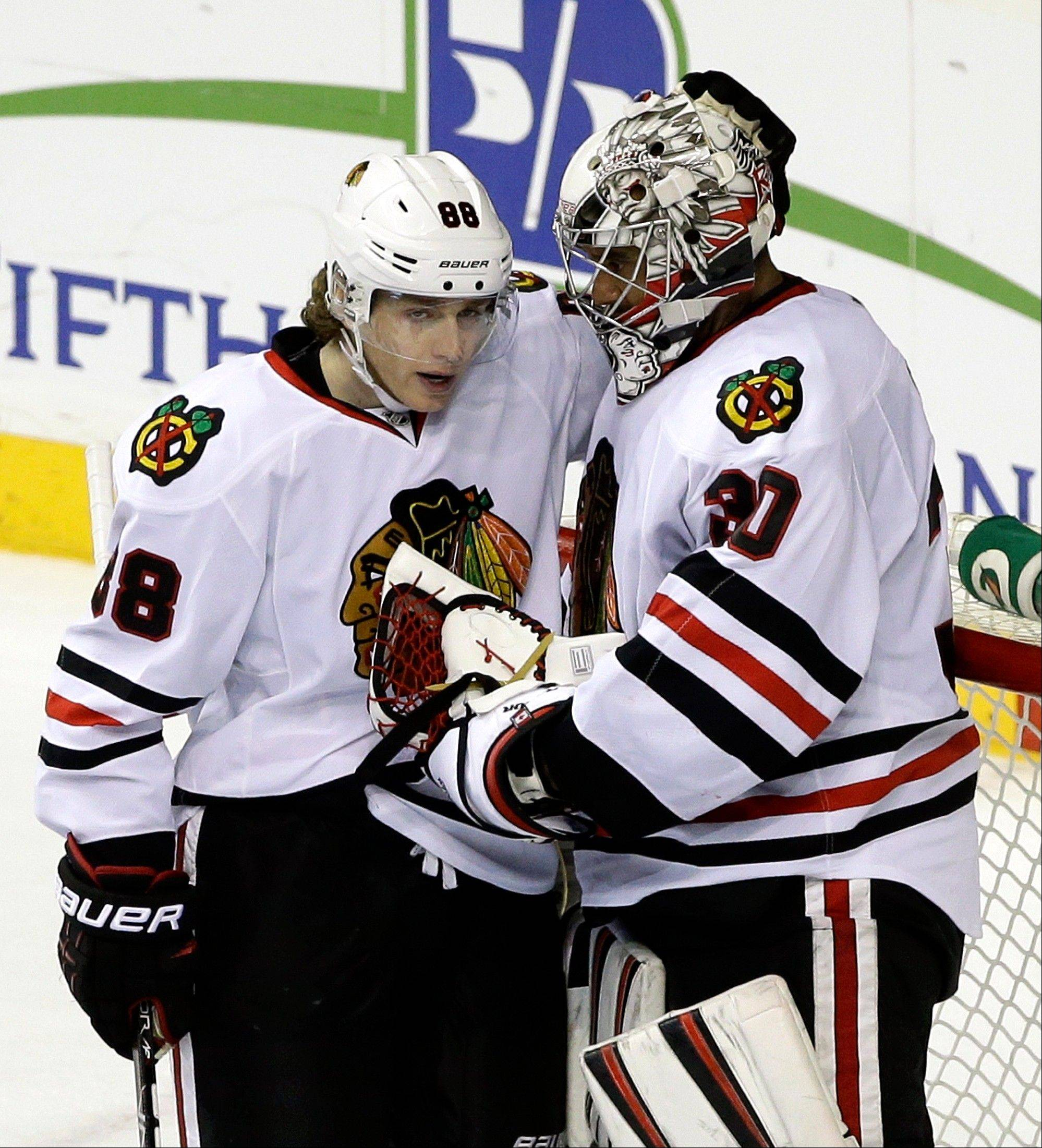 Patrick Kane congratulates goalie Ray Emery after the Blackhawks shut out the Nashville Predators on Saturday.
