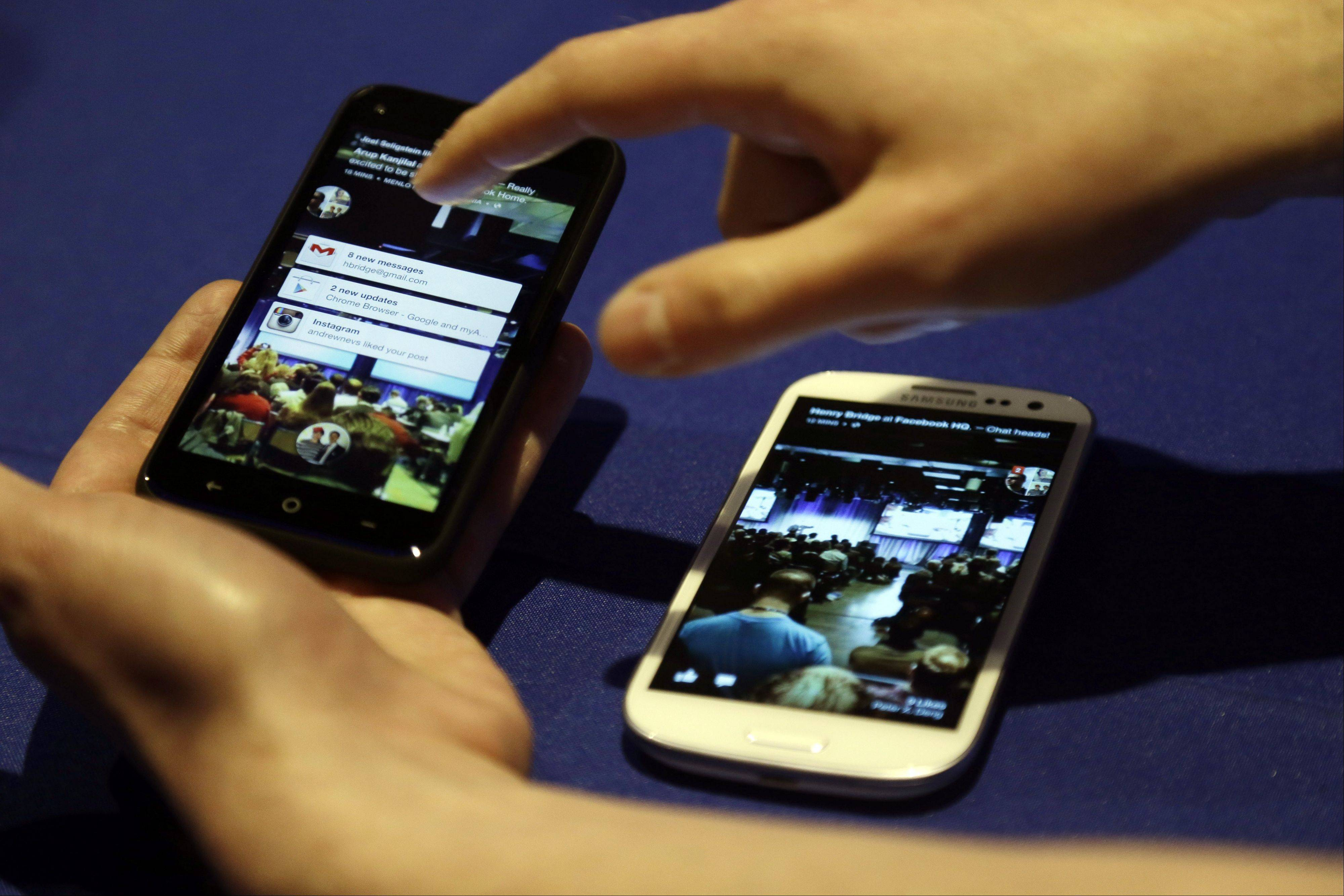 Cellphones with the a new Facebook interface are displayed Thursday at the company's headquarters in Menlo Park, Calif.