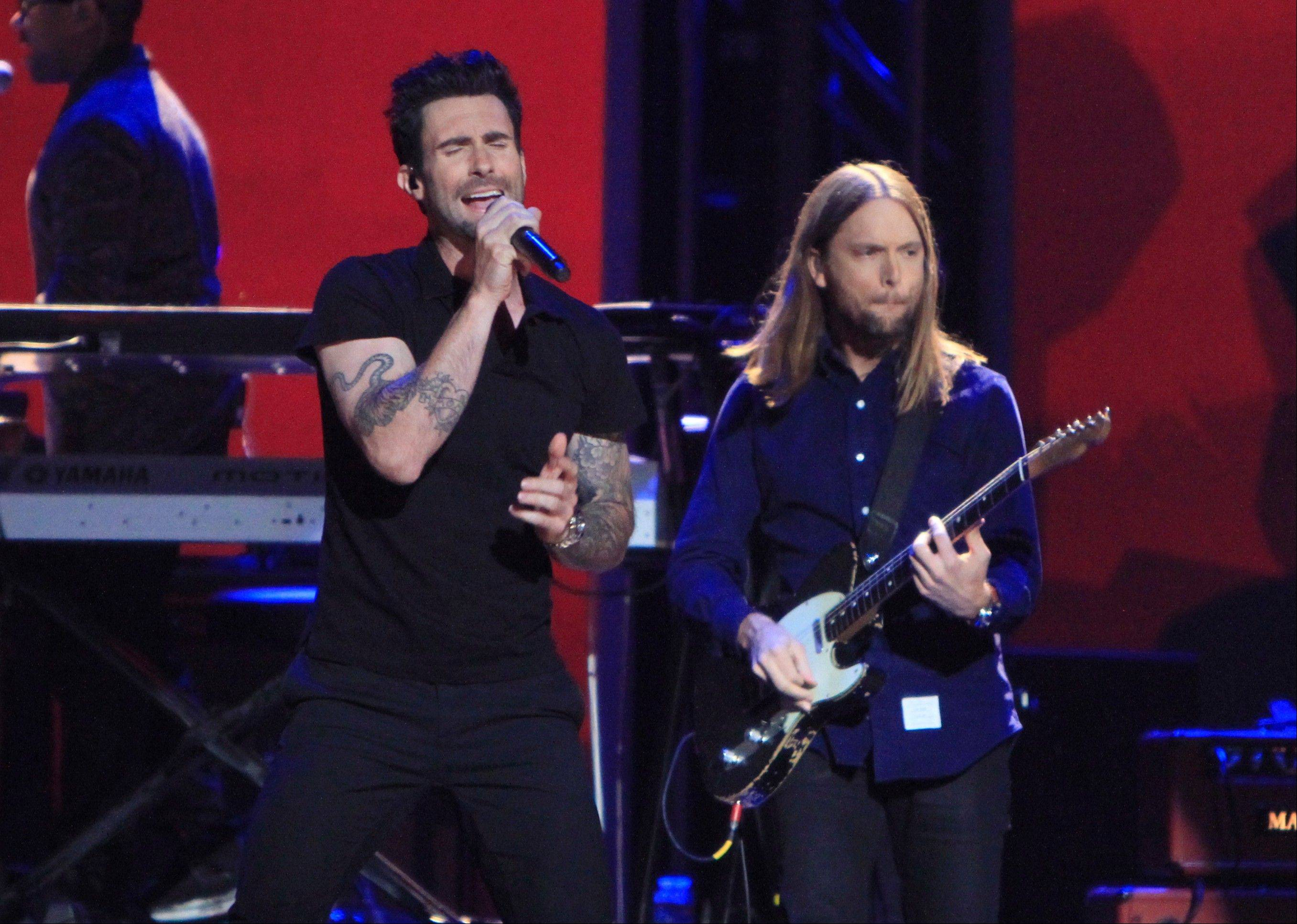 Adam Levine, left, James Valentine and the rest of Maroon 5 headline the Allstate Arena in Rosemont on Saturday, April 6.