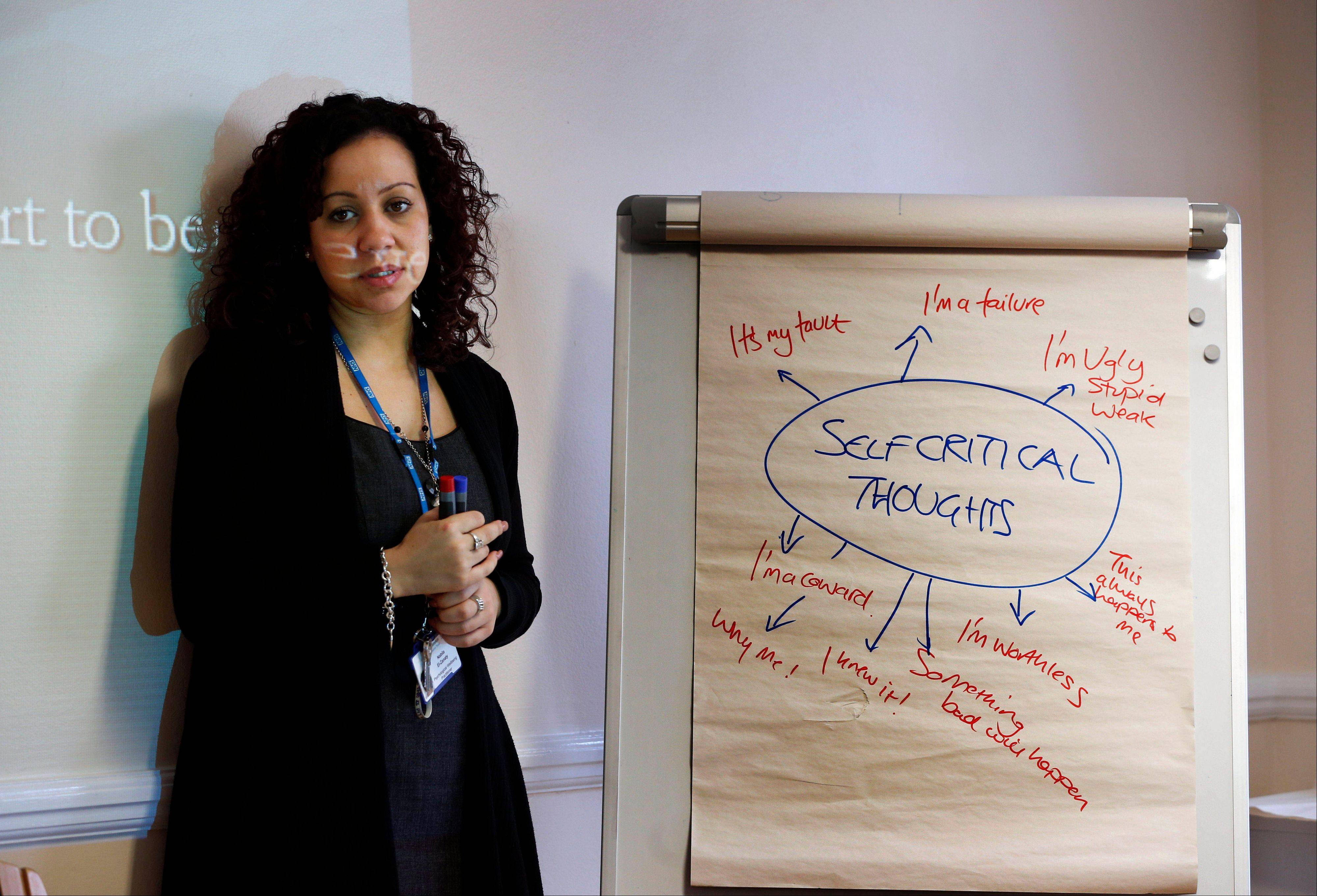 Psychological well-being practitioner Nabila El-Zanaty talks to a self-help psychological course class run by Britain�s publicly funded health system, during a session in east London. With a long wait to see a psychologist, the British government is turning to the classroom to treat people with mild to moderate mental health problems with a mix of PowerPoint presentations and group exercises.