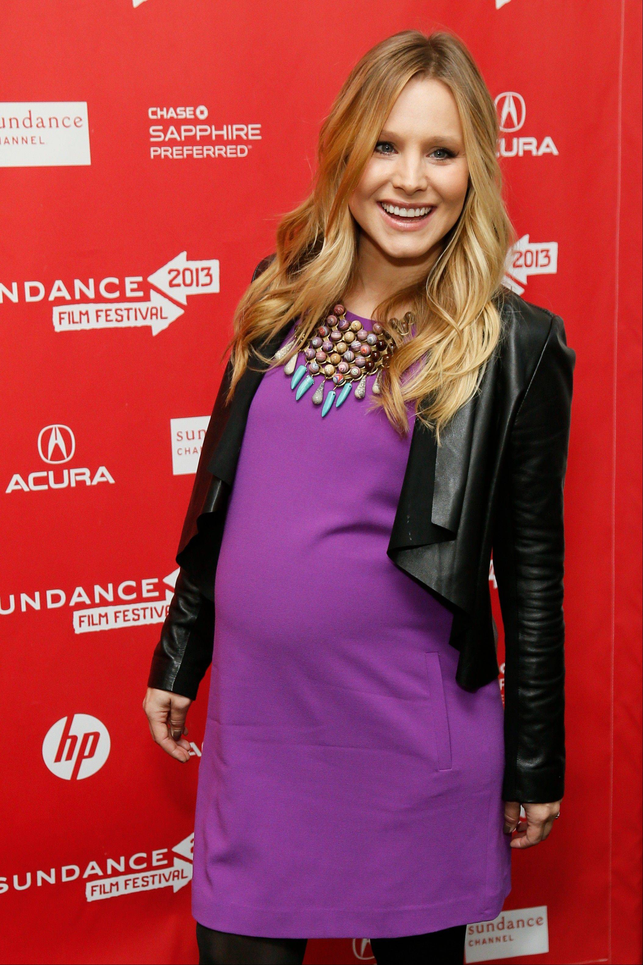 "Pregnant actress Kristen Bell at the premiere of ""The Lifeguard"" during the 2013 Sundance Film Festival in Park City, Utah. Fashion experts say a streamlined style best suits a baby bump."