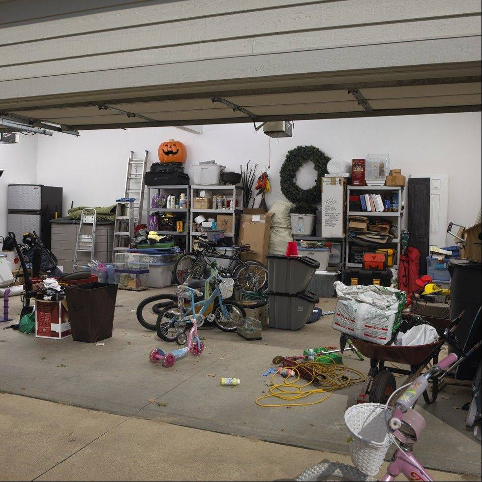 The Garage Store converted this messy garage into the organized one seen in the proceeding photo.