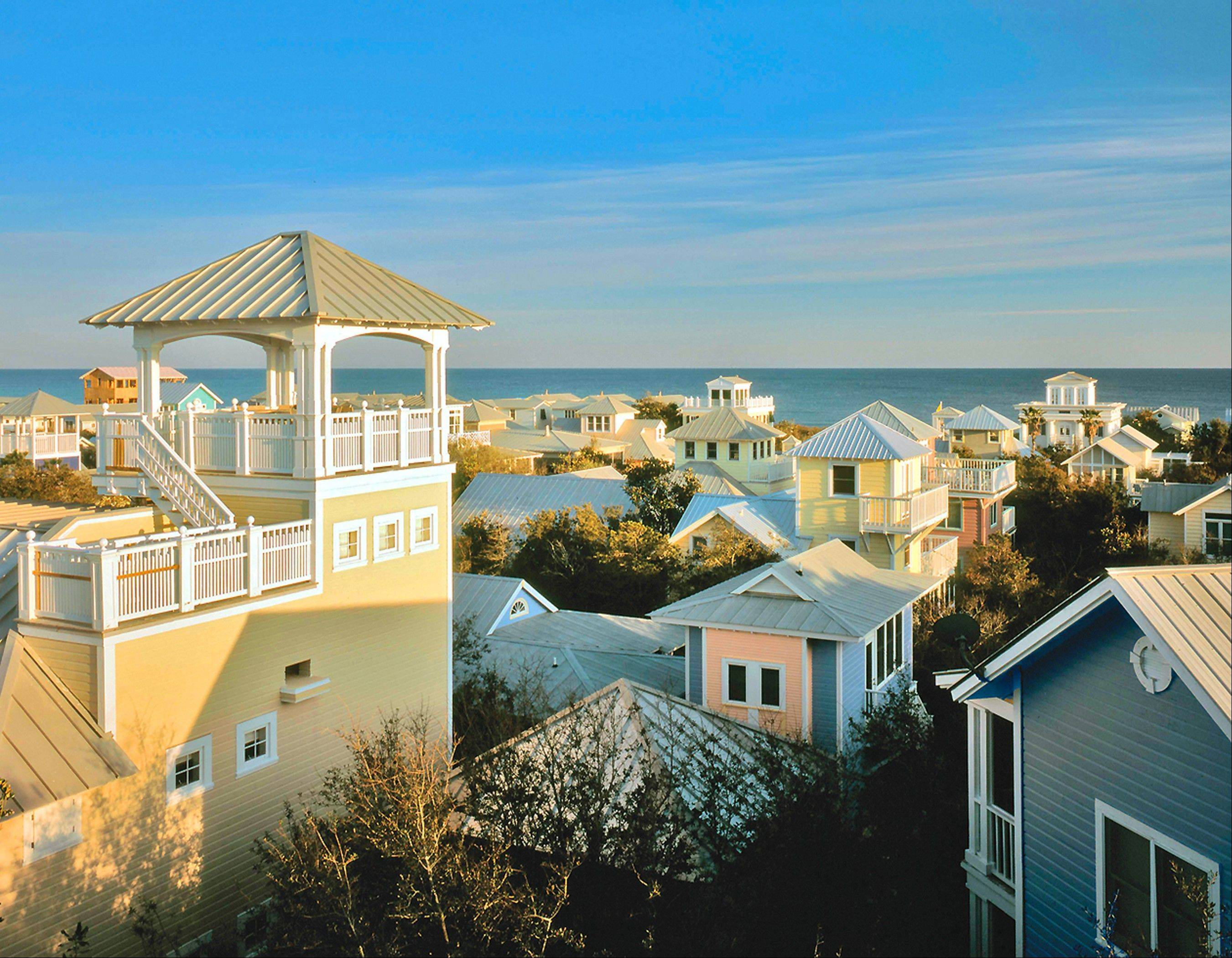 The picturesque town of Seaside, located in the Florida Panhandle, is known for its pastel-colored homes and beautifully landscaped walkways and public areas.