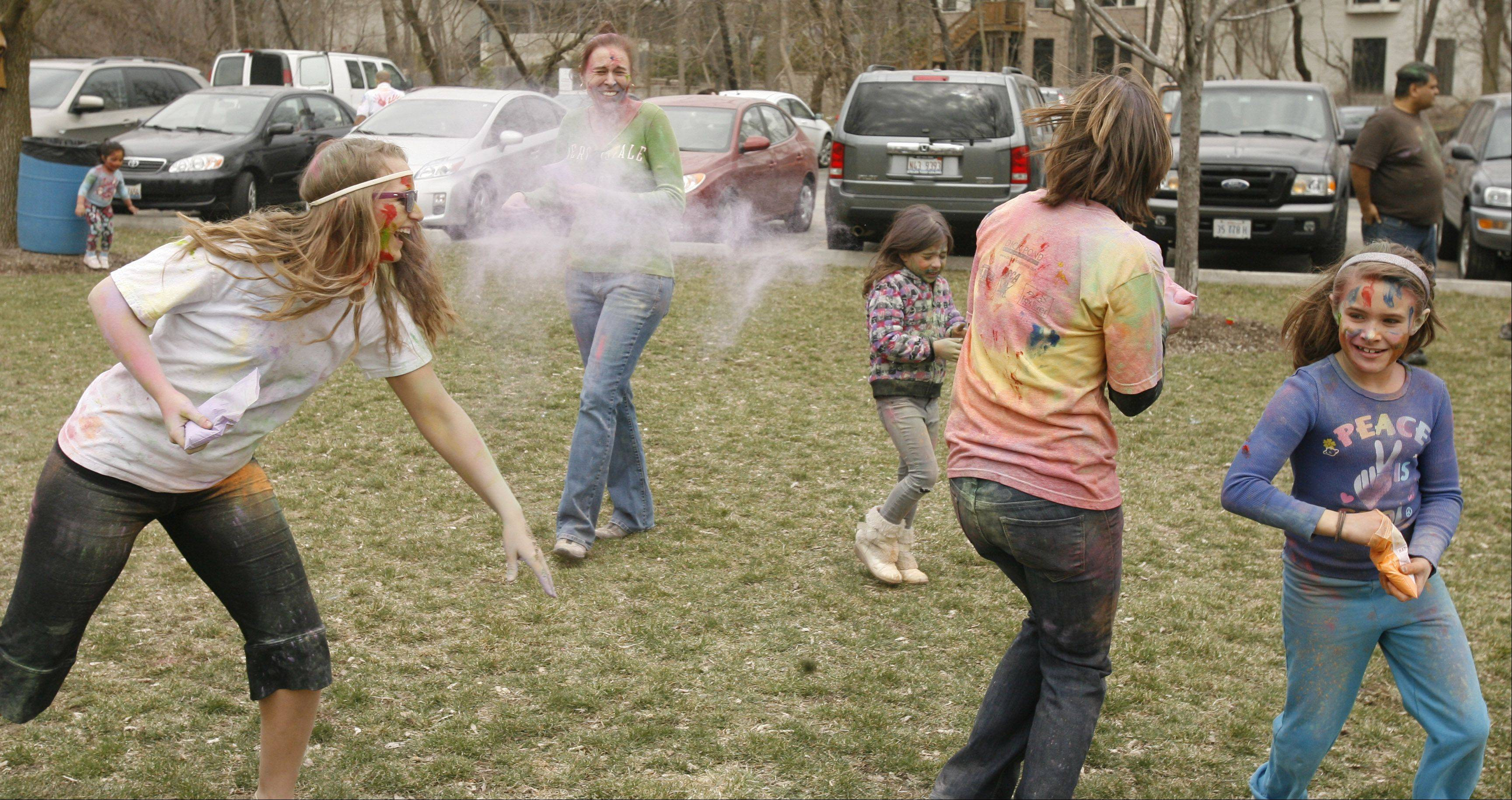 Olivet Nazarene University theology major Sydney Hunt of Normal awaits a cloud of color Saturday during the Simply Vedic Cultural Society's Festival of Colors in Naperville. The event celebrated the Hindu festival Holi, which marks the coming of spring and encourages participants to throw their worries to the wind.