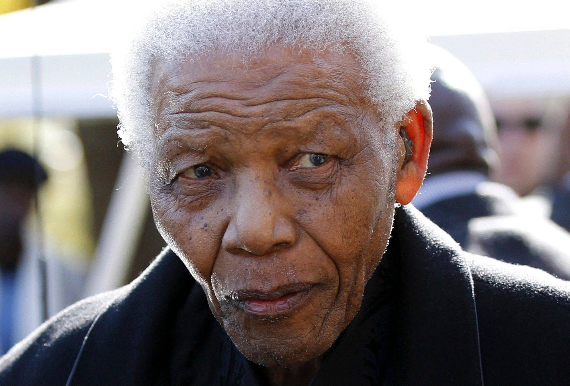 In this June 17, 2010, file photo, former South African President Nelson Mandela leaves the chapel after attending the funeral of his great-granddaughter Zenan