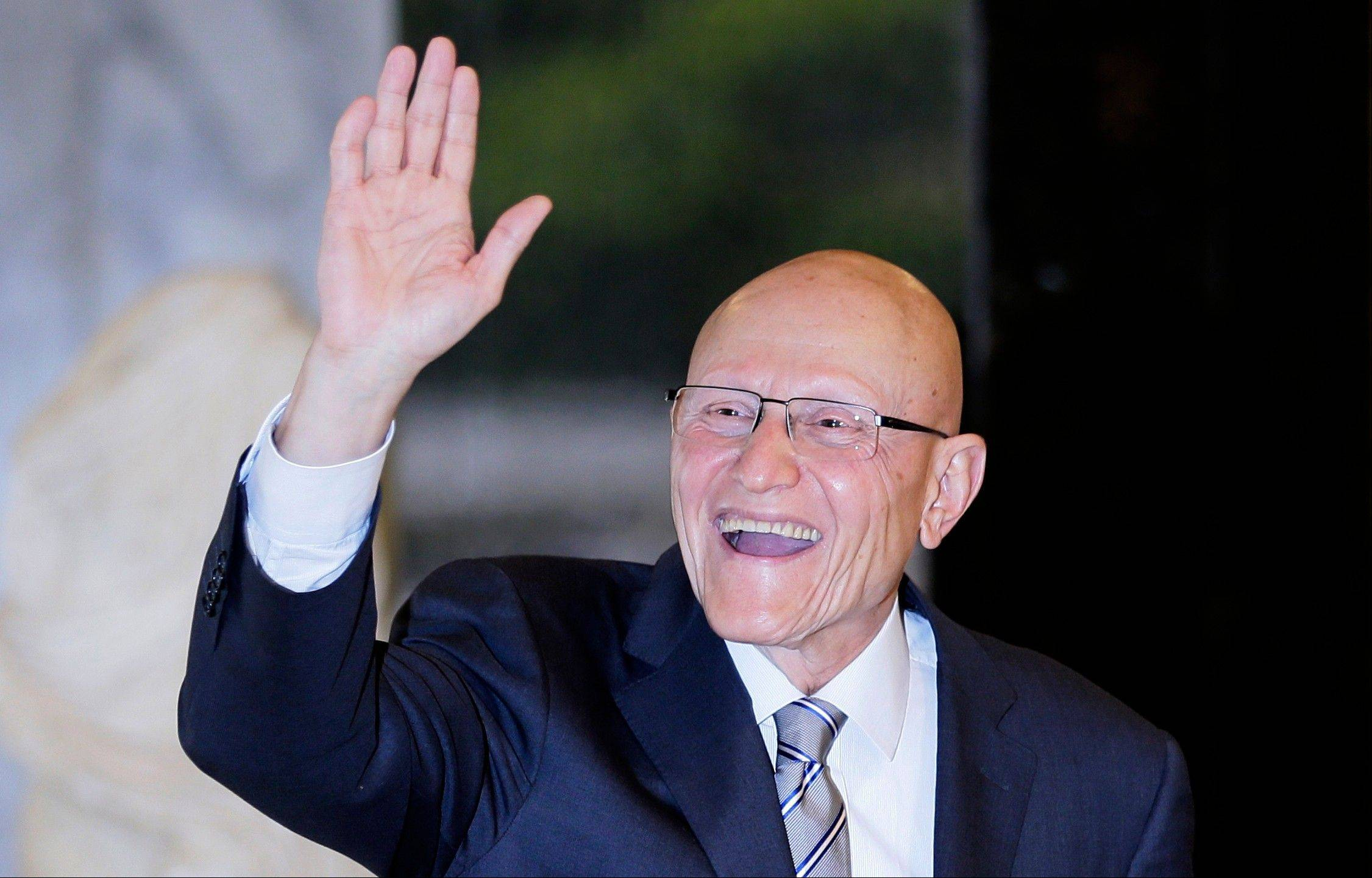 Lebanese Prime Minister designate Tammam Salam gestures upon his arrival to the presidential palace in Baabda, east of Beirut Saturday, April 6. Following two days of consultations, President Michel Suleiman asked legislator and former Minister of Culture Salam to form the new cabinet after 124 of the 128-member parliament chose him for the job.