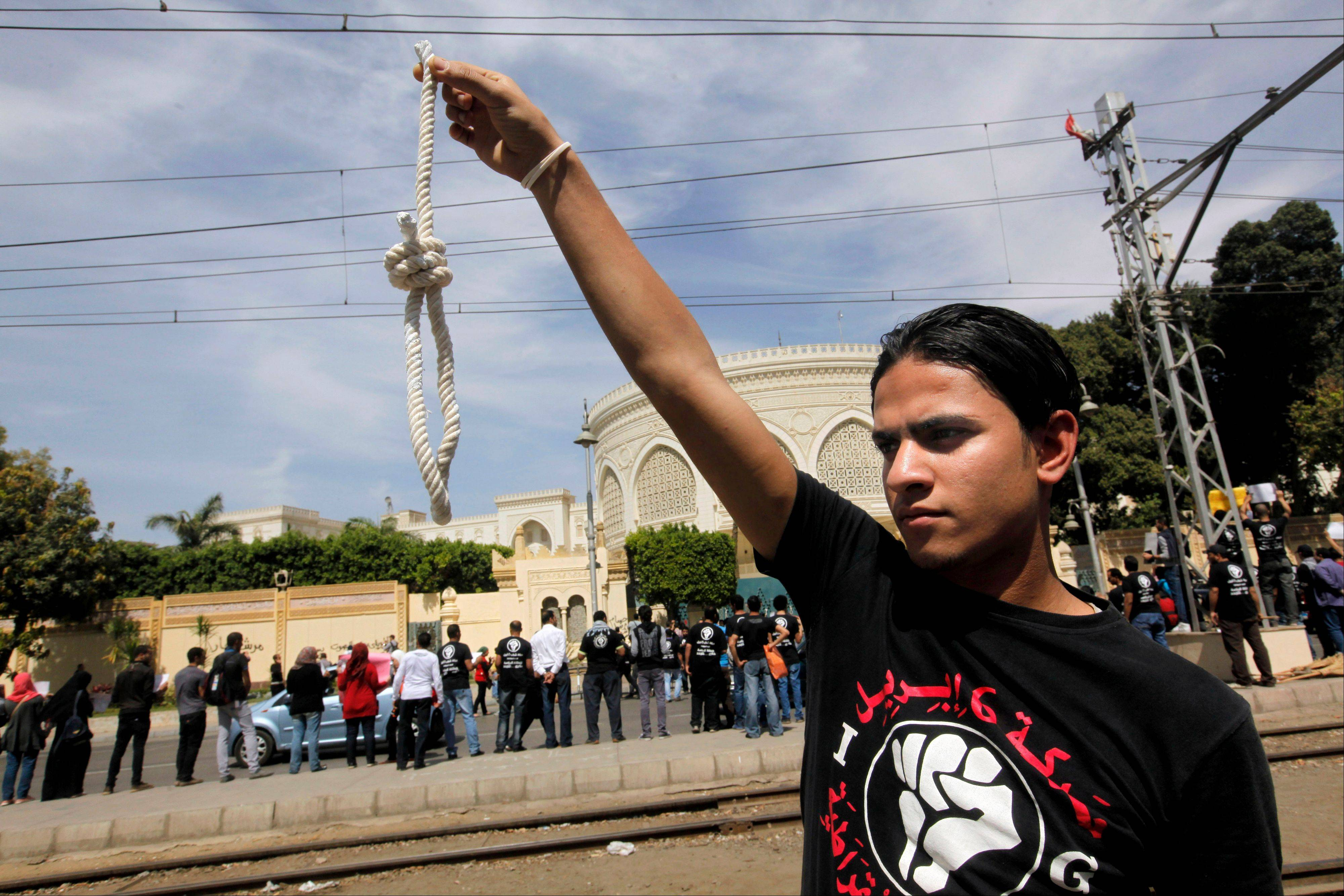 Associated PressA member of Egypt's April 6 Youth Movement holds a noose in front of the presidential palace in Cairo, Egypt, Saturday, April 6. The group is rallying to mark its fifth anniversary and to protest against President Mohammed Morsi.