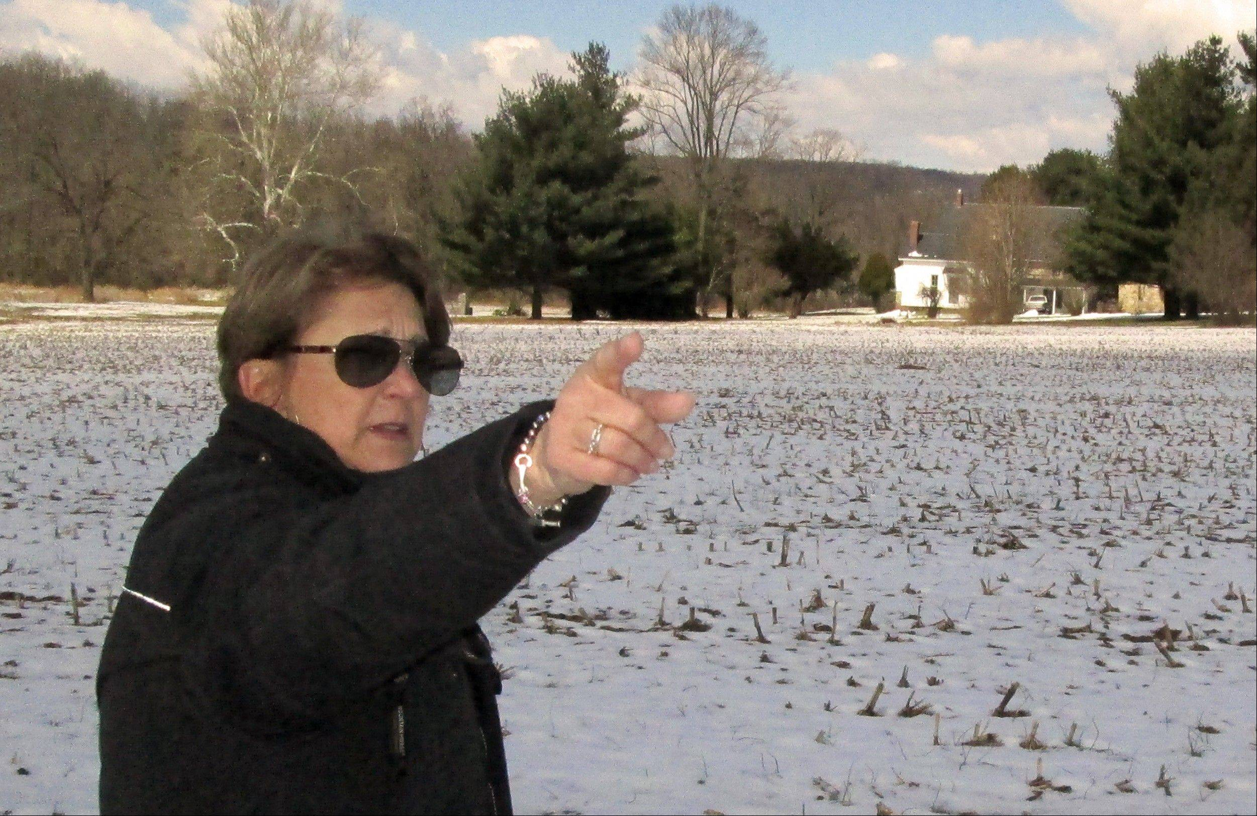 Associated PressIn this photo from March 26, Carol Tanzola, president of Friends of Camp Security, points out the property on a 47-acre parcel, located about four miles east of York, Pa. It includes the spot where a 1979 archaeological study found numerous artifacts that confirmed local lore that the area had once served as Camp Security, a prison for the English, Scottish and Canadian soldiers who were captured after defeats in the battles of Saratoga and Yorktown.