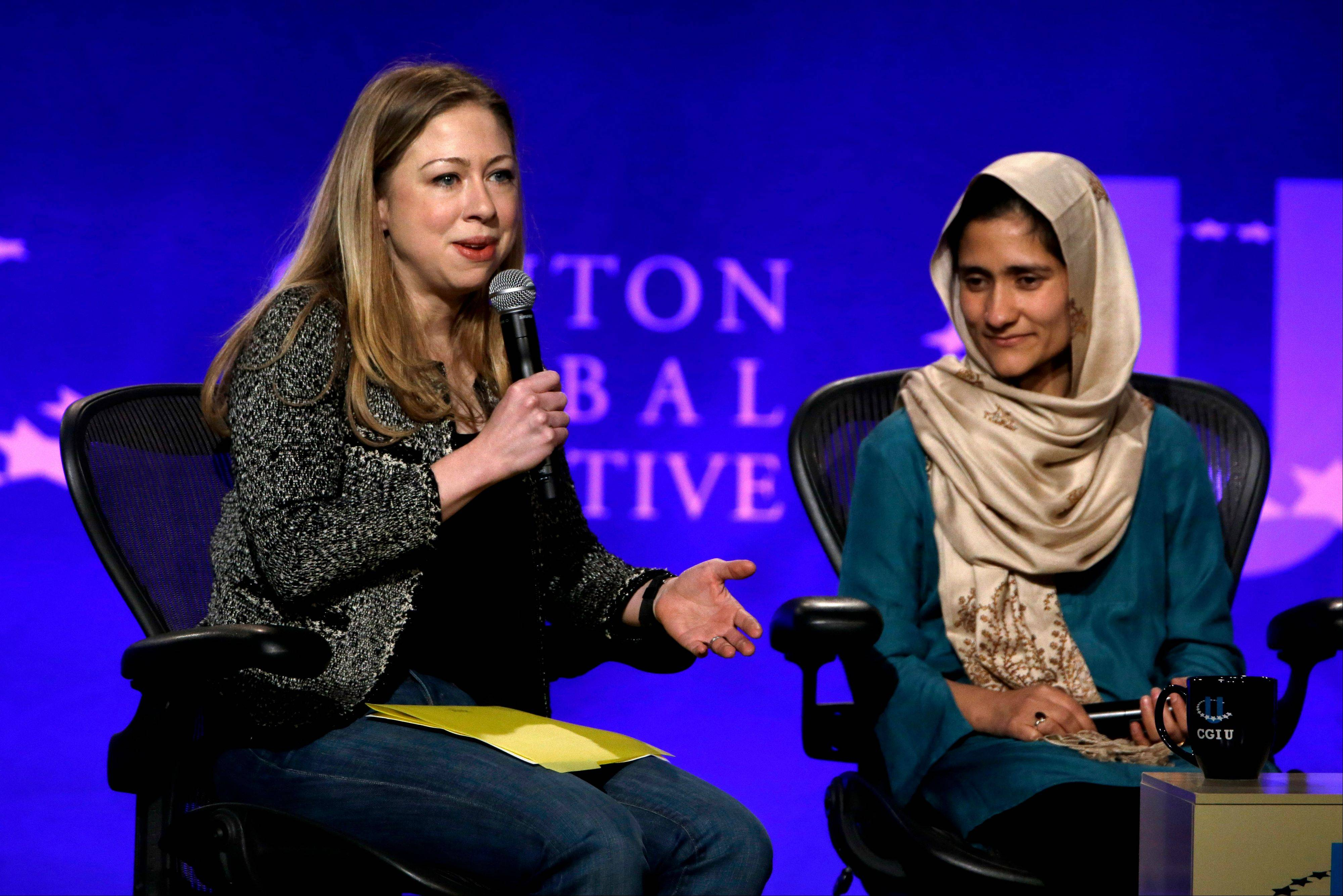 Chelsea Clinton, left, and Shabana Basij-Rasikh, managing director for the School of Leadership in Afghanistan in take part in a discussion on empowering women during the Clinton Global Initiative at Washington University Saturday, April 6, in St. Louis. More than 1,000 university students from 75 countries and all 50 states are gathered for a weekend of sessions seeking practical and innovative solutions to the world's problems.