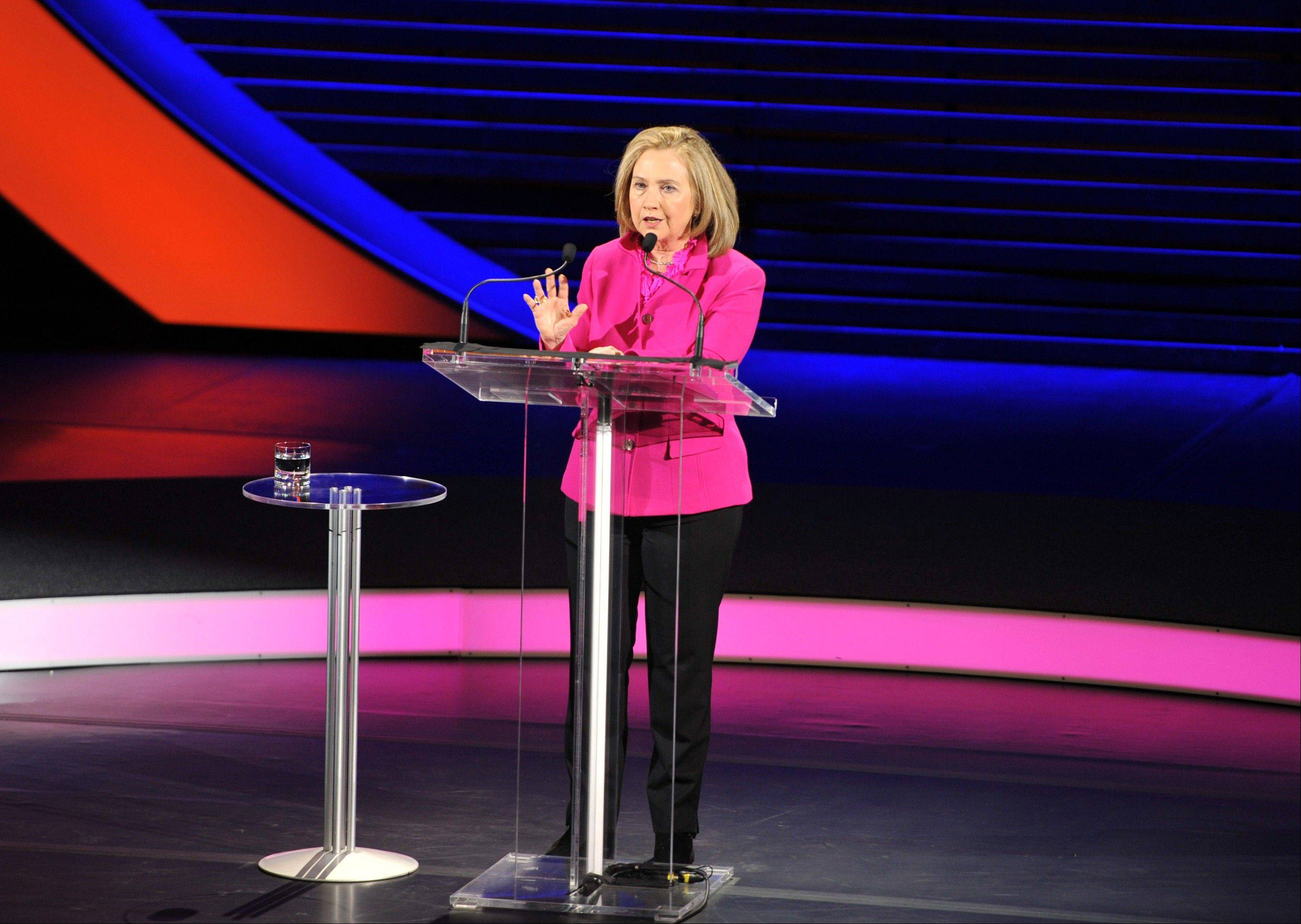This image released by Women in the World shows former Secretary of State Hillary Rodham Clinton speaking at the Women in the World Conference on Friday, April 5, in New York. Clinton is getting plenty of encouragement to run for president in 2016. Her re-emergence this past week after a two-month break brought out cheering supporters when she gave speeches focused on the issues of women and girls around the world.