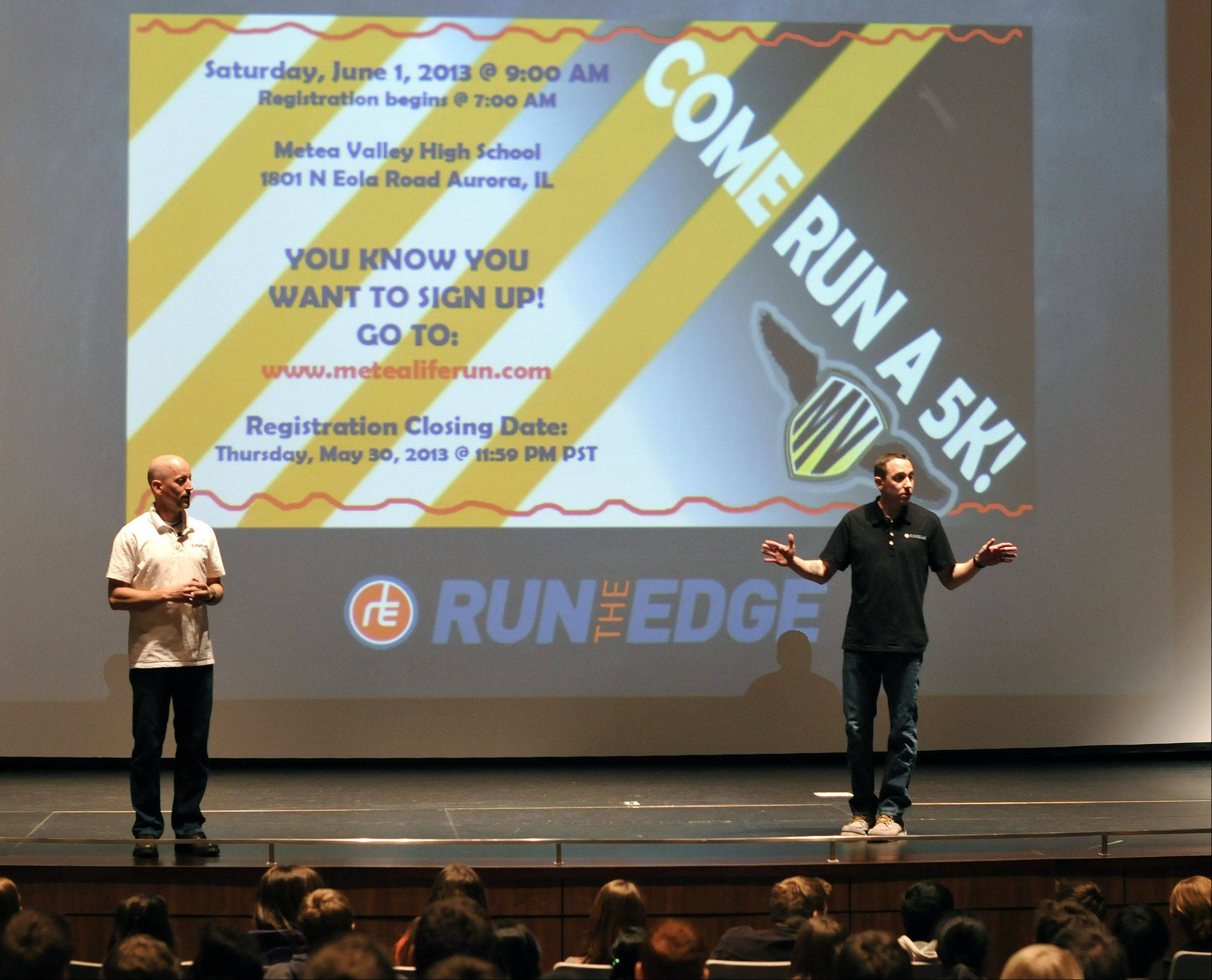 "Authors Tim Catalano and Adam Goucher speak to English classes Friday at Metea Valley High School in Aurora as the school begins a reading and running program featuring their motivational book, ""Running the Edge."""