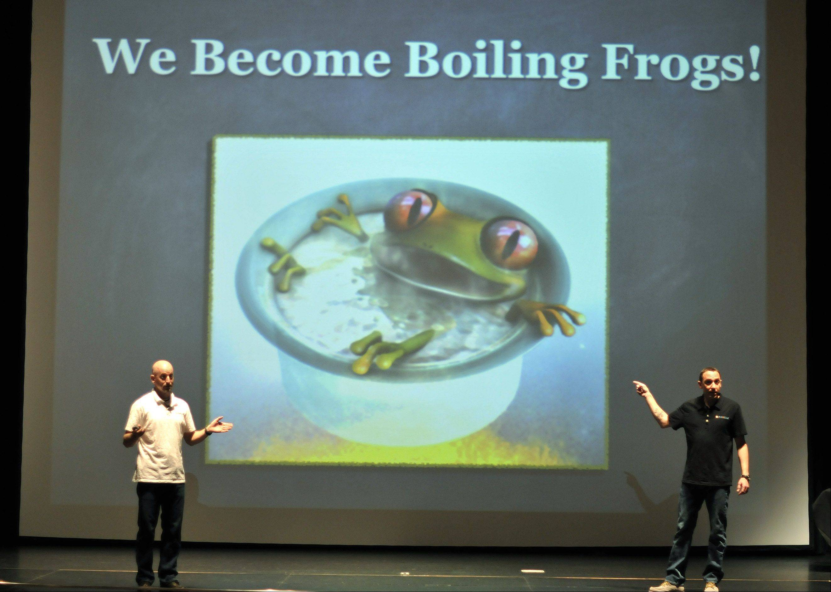 """Running the Edge"" authors Tim Catalano and Adam Goucher used metaphors and creative phrases, such as the fable of the boiled frog, to explain how a gap between life goals and results can develop gradually. They spoke Friday to Metea Valley High School students during their English classes at the school in Aurora."