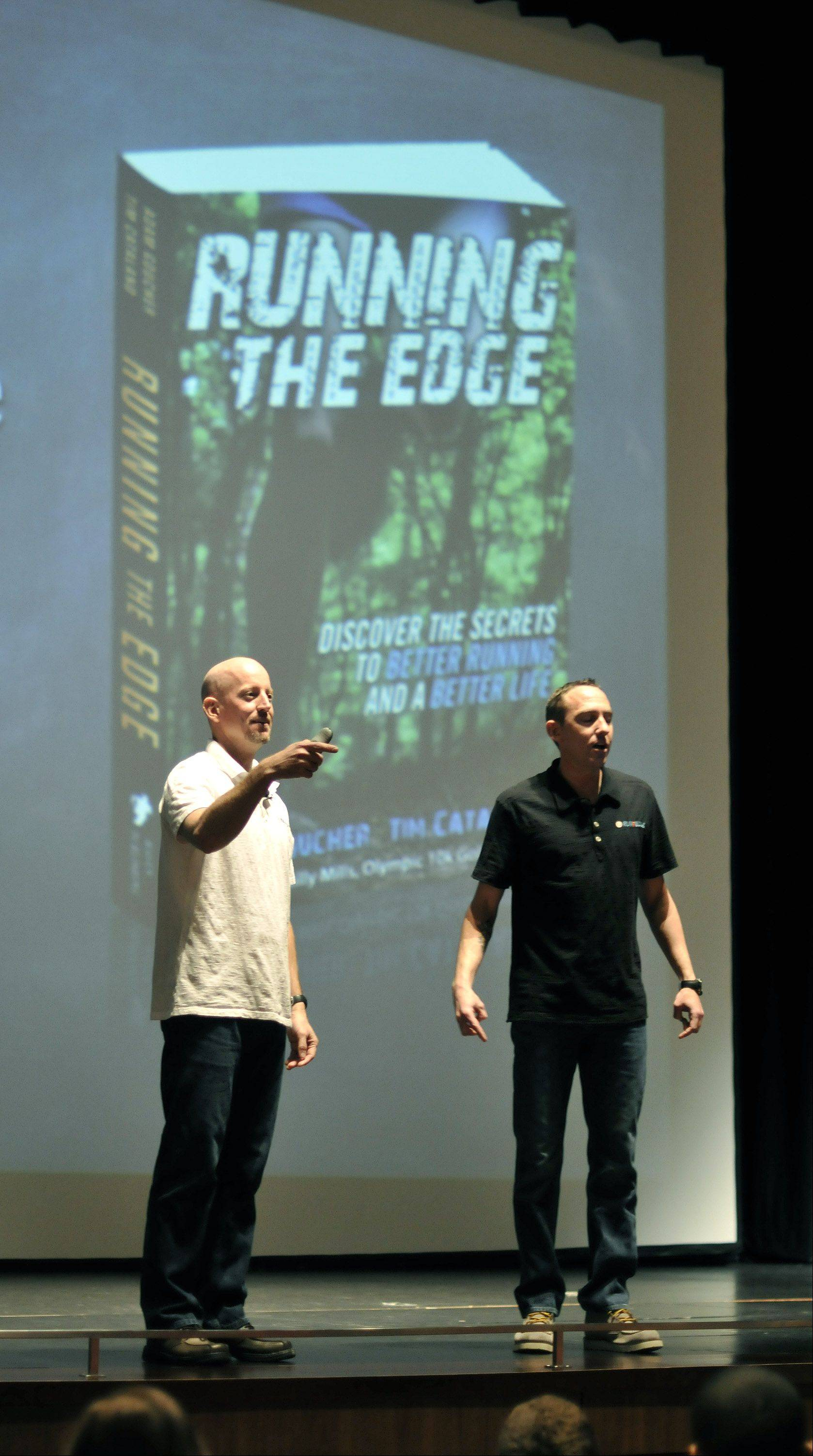 "Authors Tim Catalano and Adam Goucher discuss their book ""Running the Edge"" with Metea Valley High School students Friday as the Aurora school begins a reading and running program featuring the book. The program culminates with a 5K race June 1 that is open to students, staff and the community."