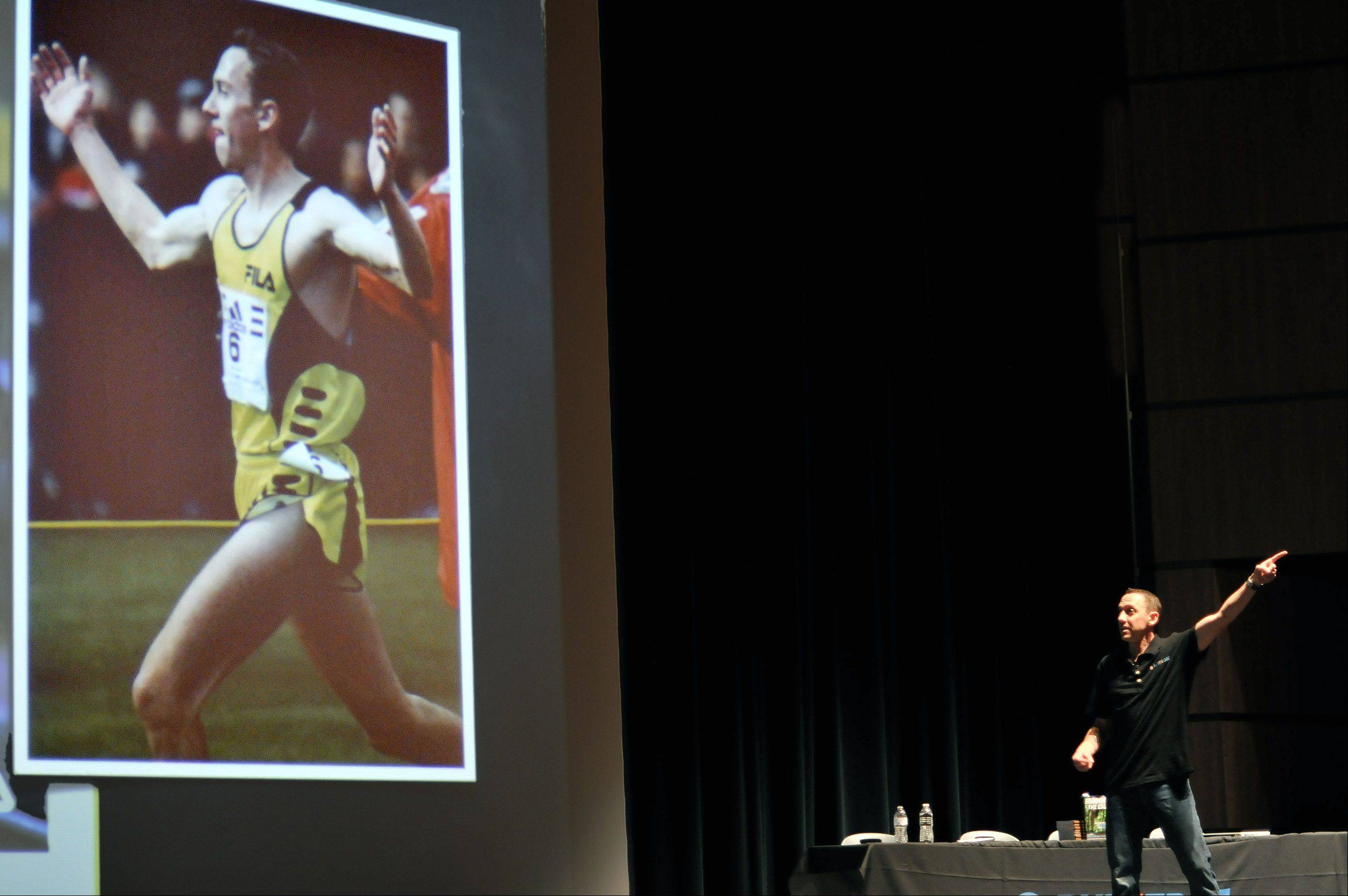 "Author and former Olympic runner Adam Goucher summarizes his running achievements to Metea Valley High School students during their English classes Friday in Aurora. The students are beginning a schoolwide reading program featuring ""Running the Edge,"" a book Goucher cowrote with friend and fellow runner Tim Catalano."