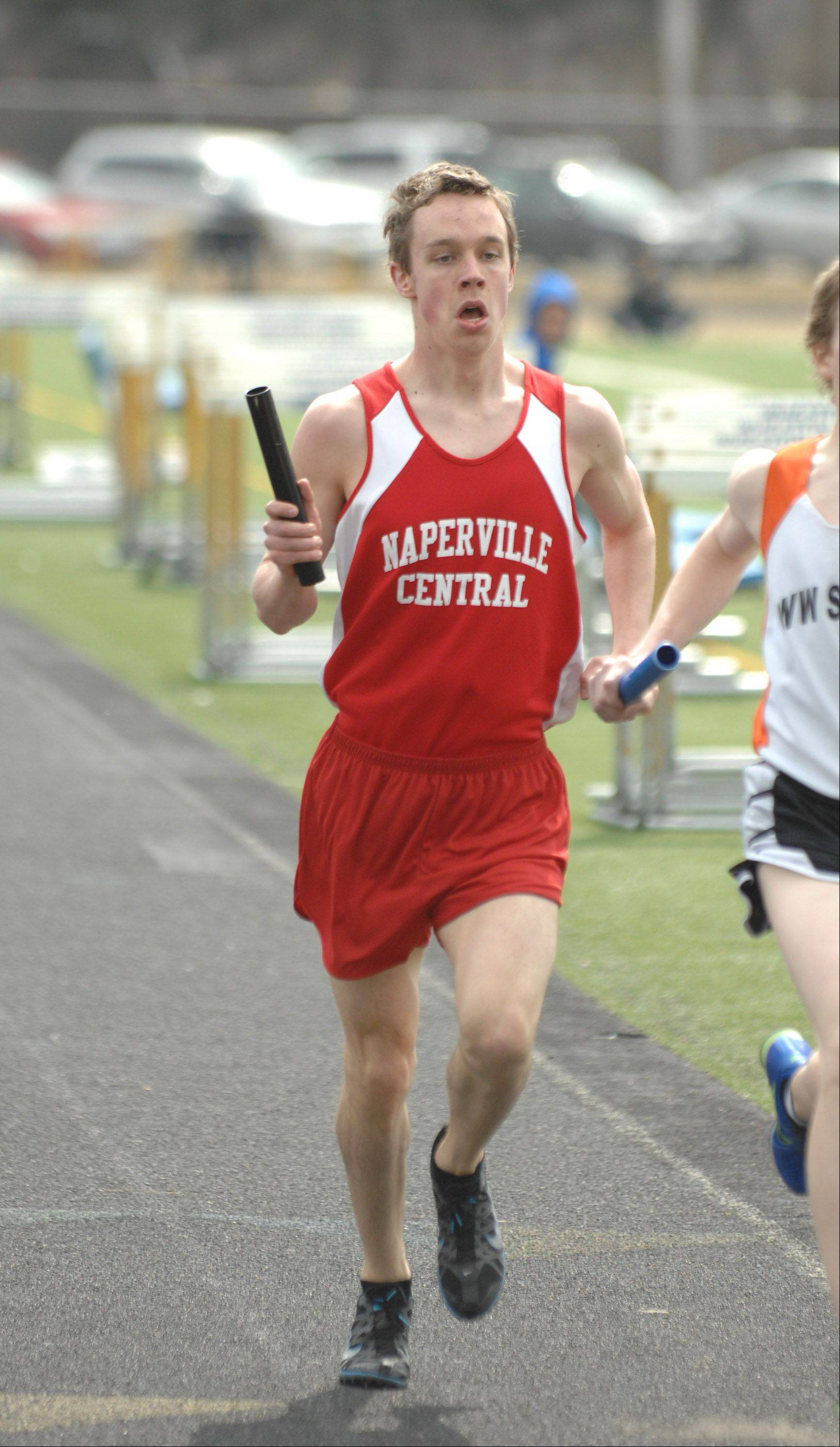 Matthew Stren of Naperville Central run in the 4x800 relay during the Wheaton North Best 4 boys track invitational Saturday.