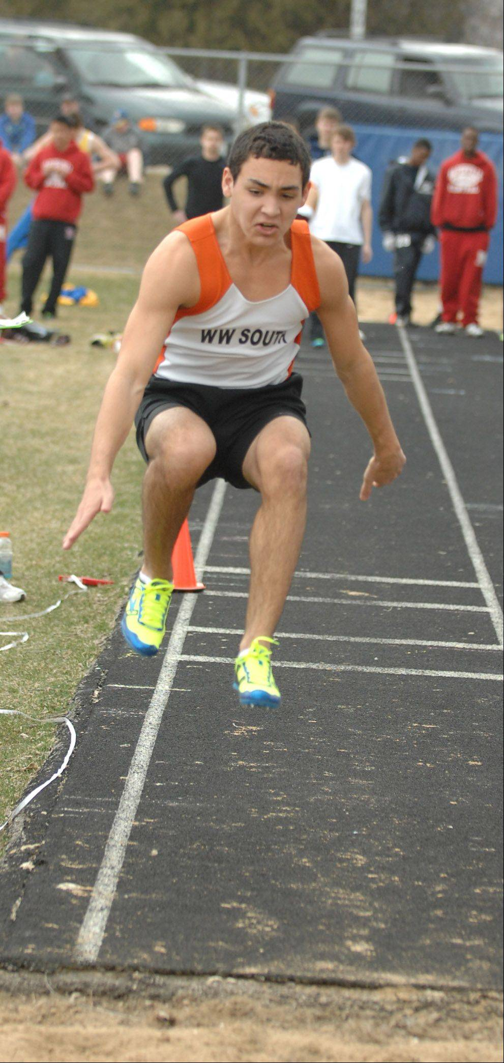 Anthony Karahalios of Wheaton Warrenville Southtakes partin the triple Jump during the Wheaton North Best 4 boys track invitational Saturday.