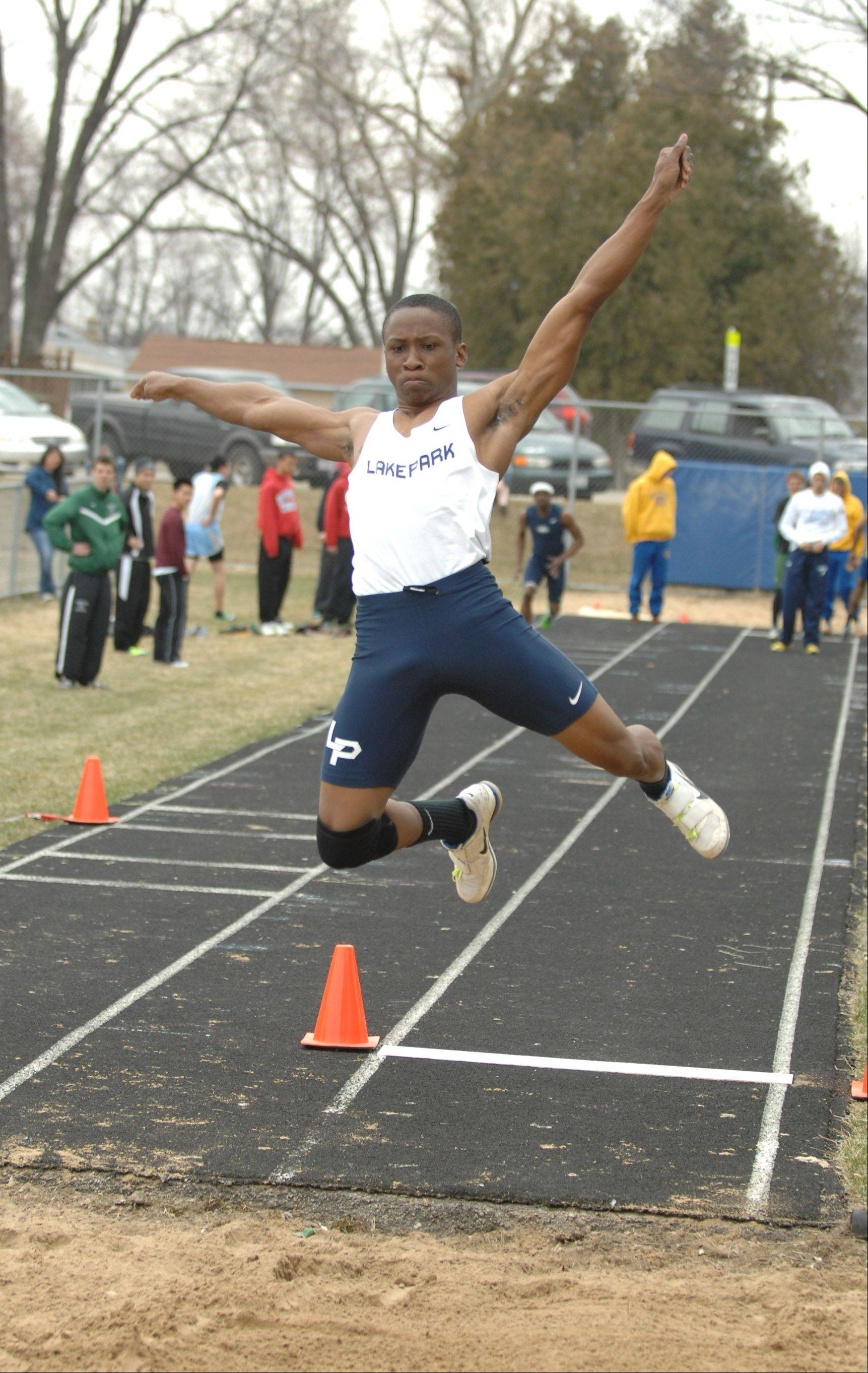 Marcus Jegede of Lake Park takes part in the long jump during the Wheaton North Best 4 boys track invitational Saturday.