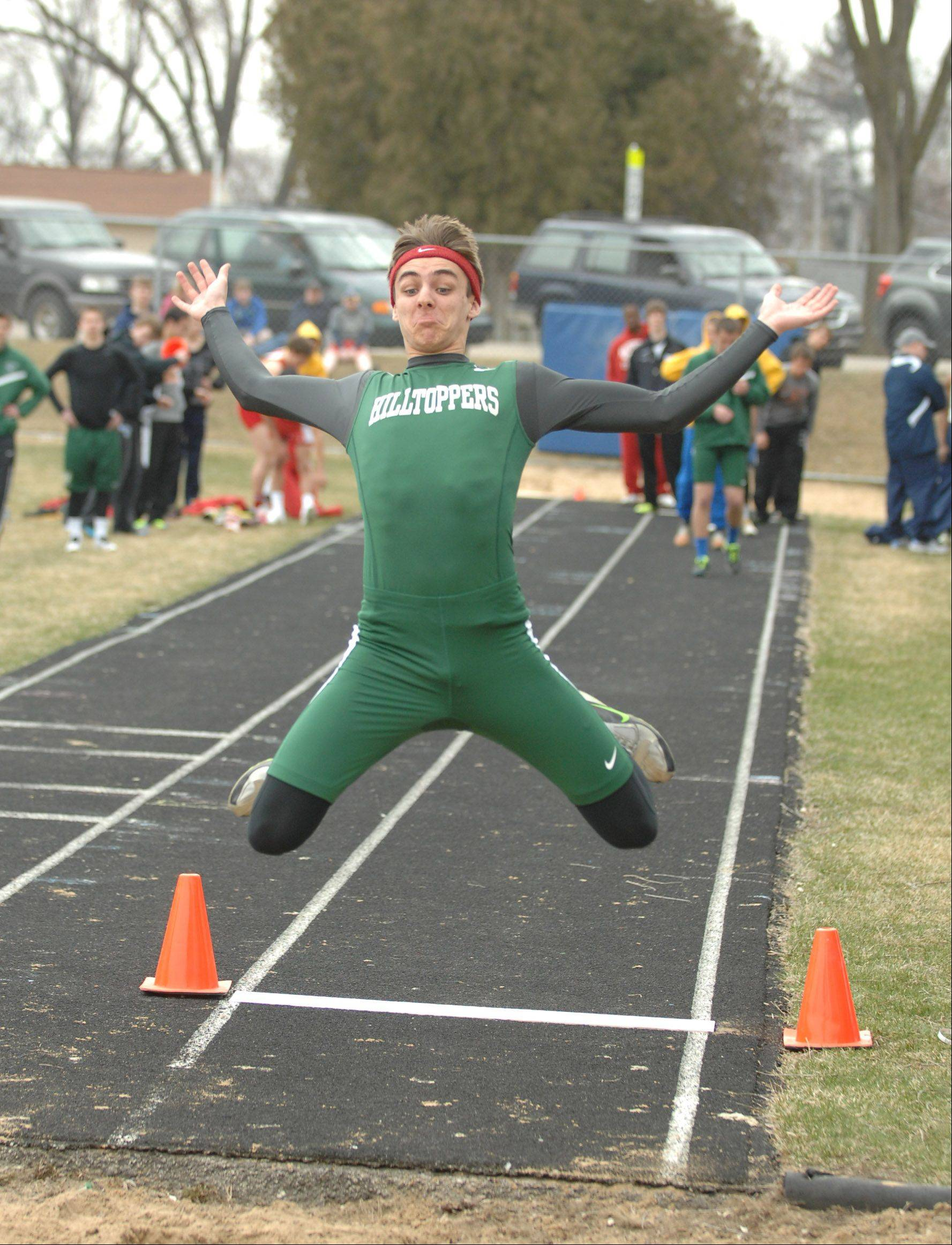 Pat Kelly of Glenbard West takes part in the long jump during the Wheaton North Best 4 boys track invitational Saturday.