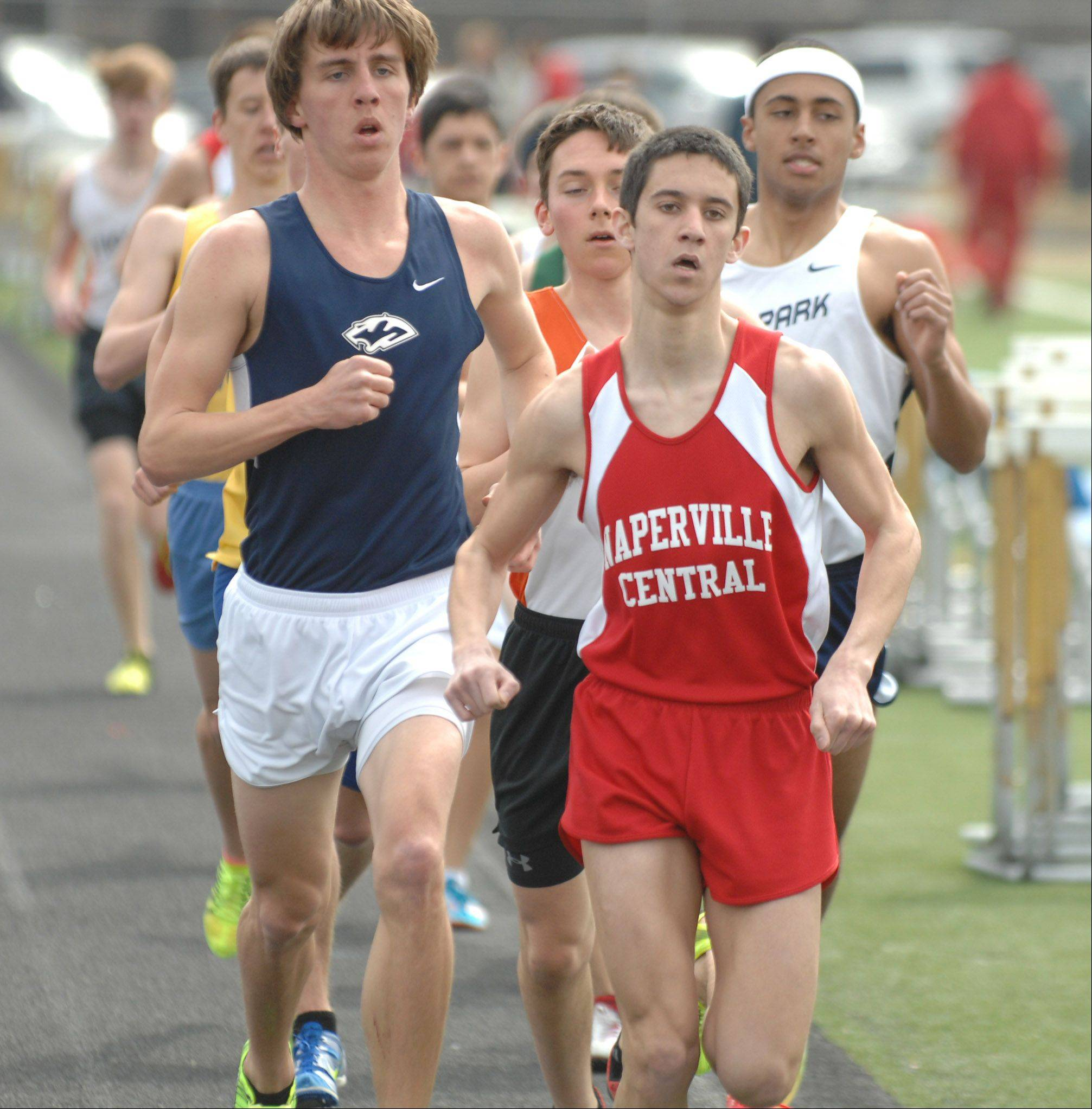 Ethan Brodeur of Naperville Central takes the lead during in the 3200 run at the Wheaton North Best 4 boys track invitational Saturday.