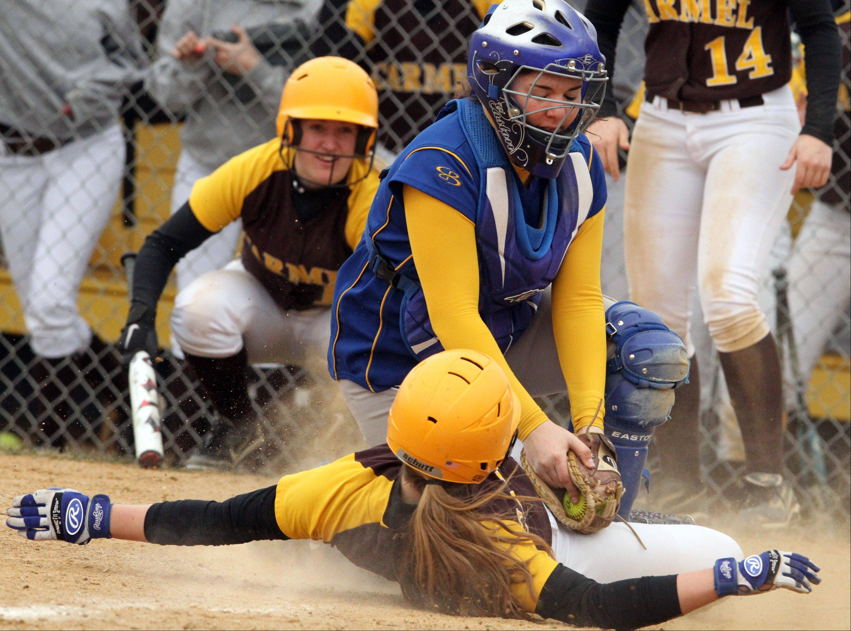 Warren catcher Sam Belletini tags Carmel's Amanda Elert out at home plate at Warren on Saturday.