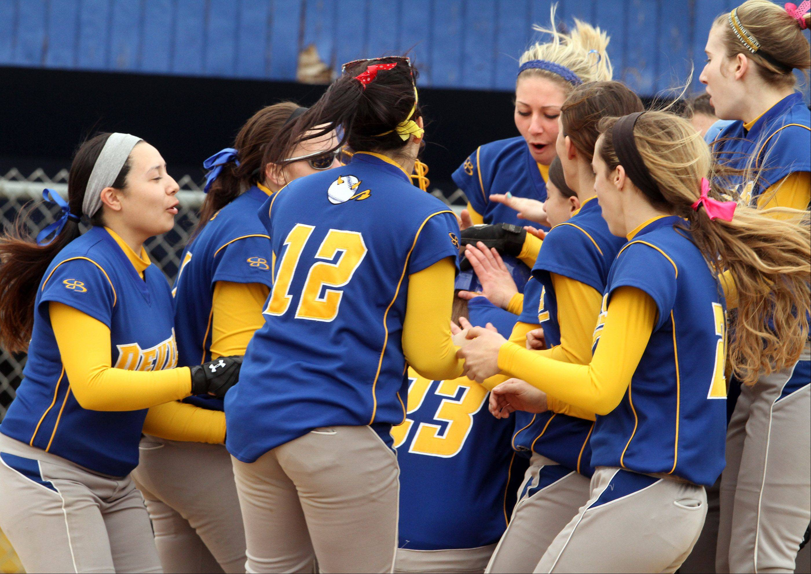 Warren celebrates a home run by Amy Ricci (lower center, No. 23) against Carmel pitcher Mia Dicara at Warren on Saturday.