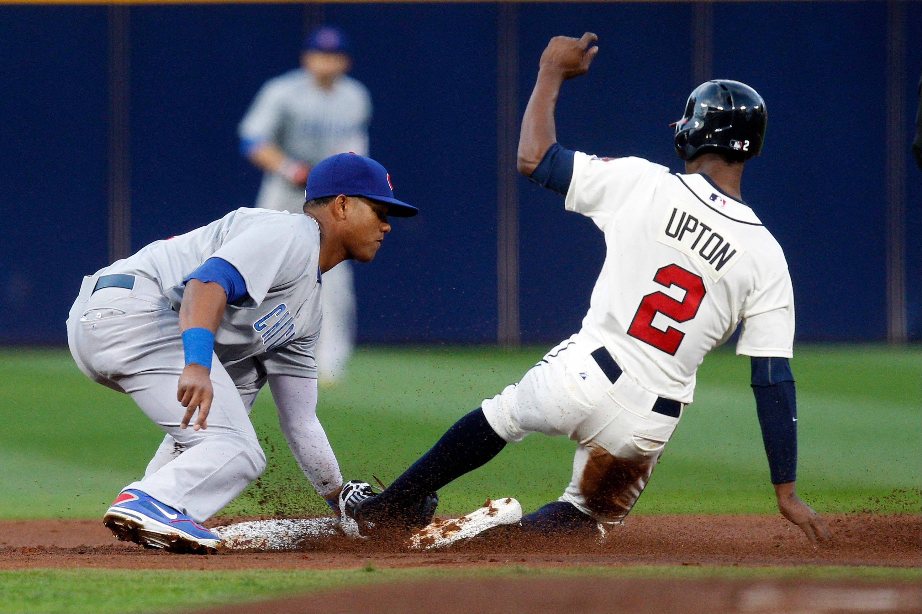 Chicago Cubs short stop Starlin Castro, left, tags Atlanta Braves' B.J. Upton out as he slides into second during Saturday night in Atlanta. The Braves beat the cubs 6-5.
