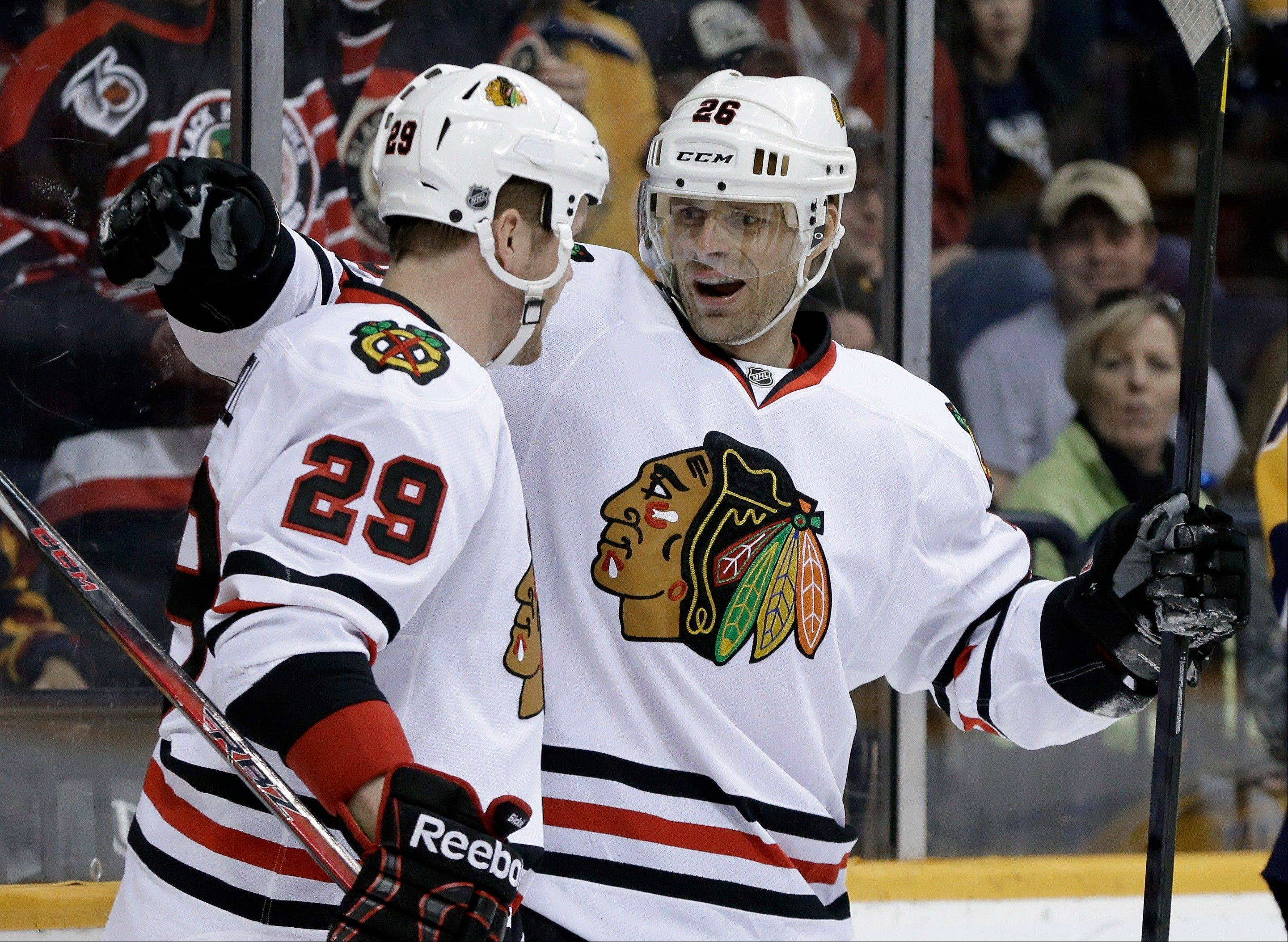 Blackhawks left wing Bryan Bickell is congratulated by Michal Handzus after Bickell scored on a Handzus assist for the only goal in Saturday's victory against the Predators at Nashville.