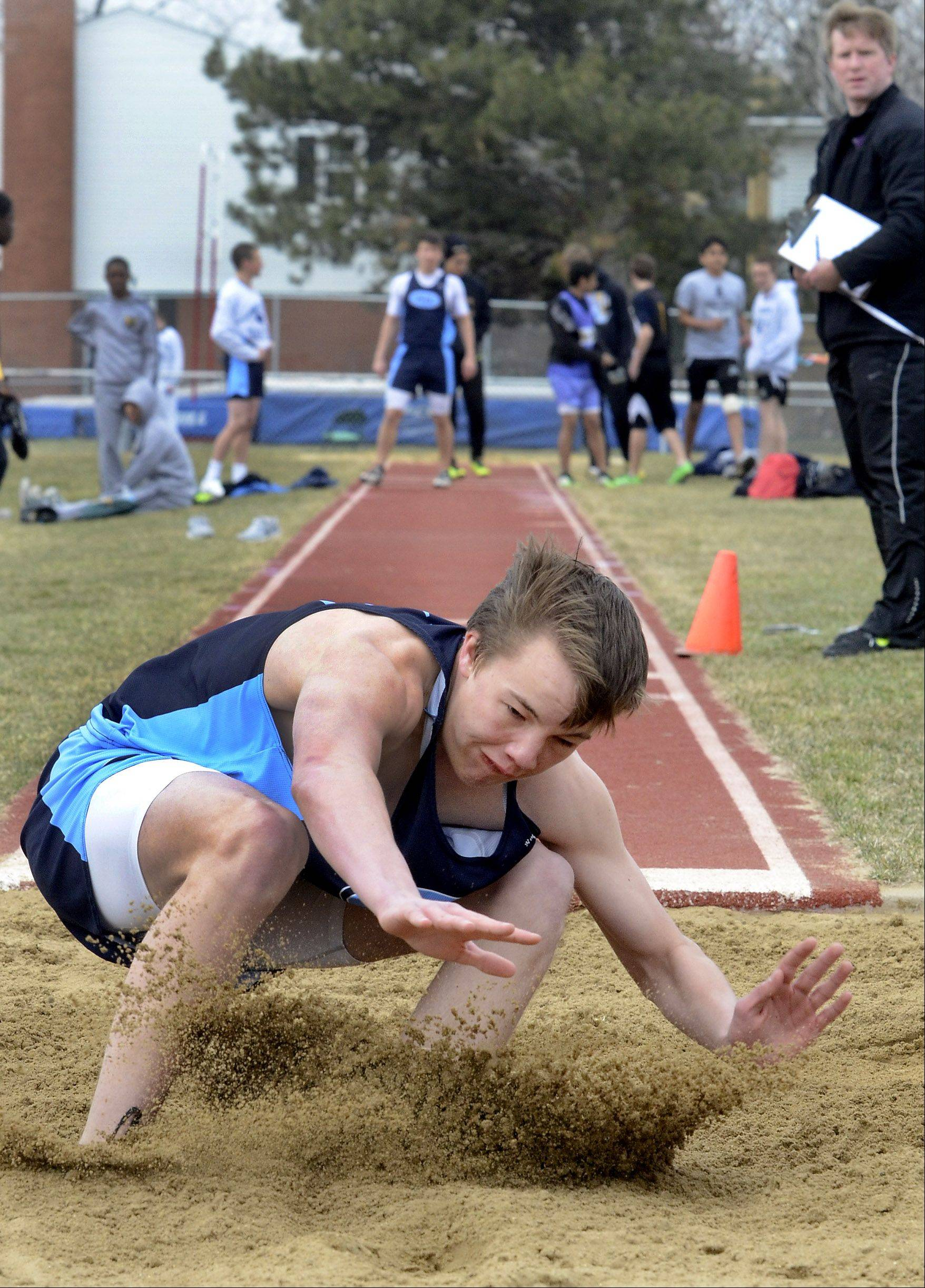 Jake Schroeder of Prospect competes in the triple jump at the Prospect Relays on Saturday.