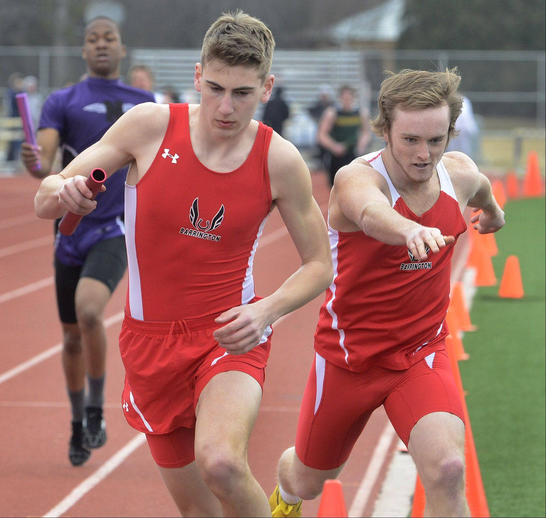 Barrington's Ryan Skelly hands off to Conrad Eiring, foreground, during the 3,200-meter relay at the Prospect Relays on Saturday.