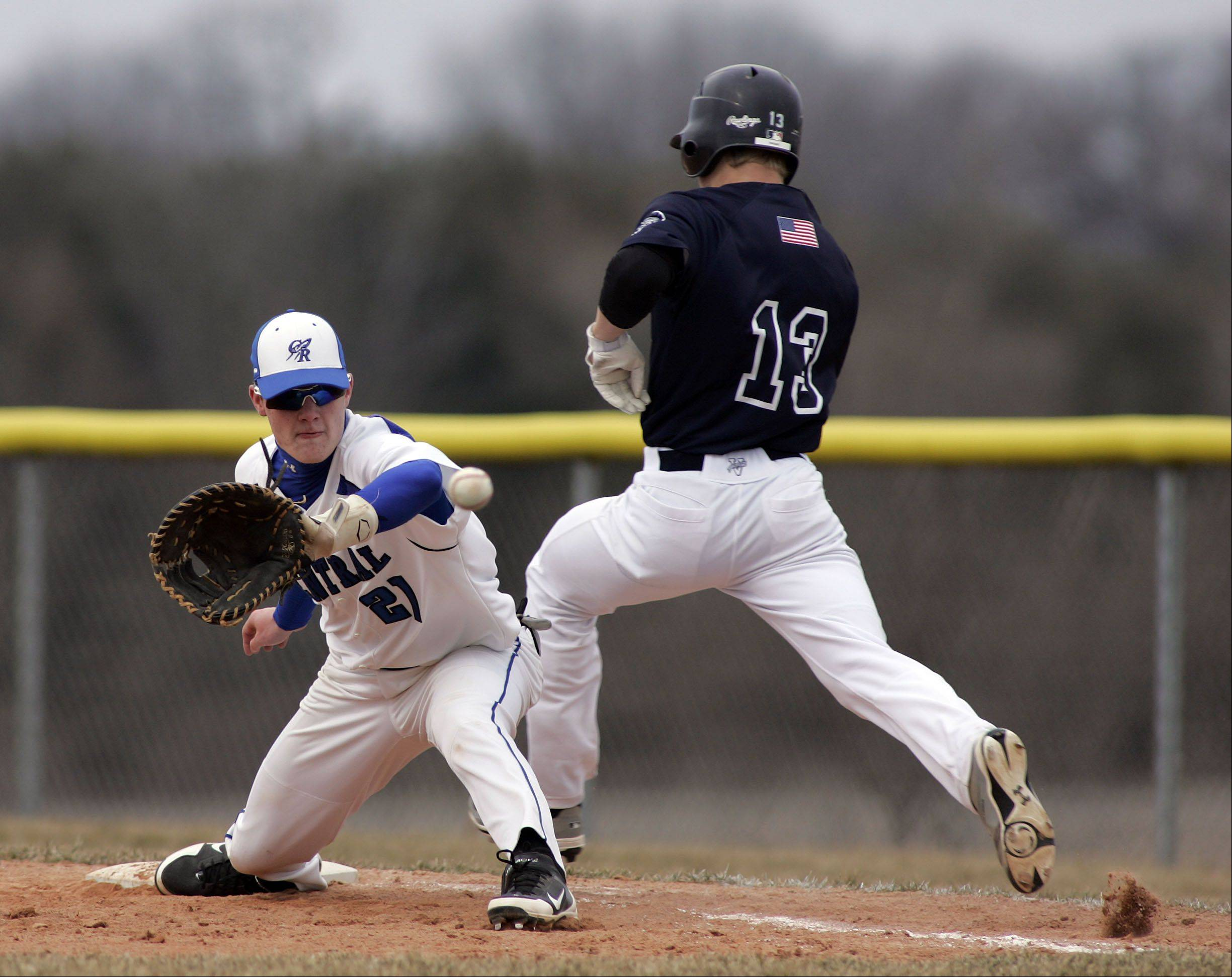 Cary-Grove's Jeremy Vasquez can't quite get to the base in time as Burlington Central's Danny Gerke reels in the ball during baseball Saturday at Burlington Central.