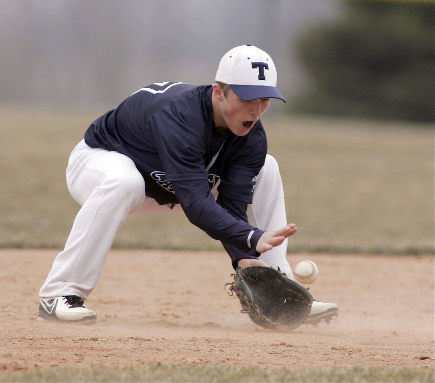 Cary-Grove's Matt Sutherland pulls in a ground ball during Cary-Grove at Burlington Central baseball Saturday.