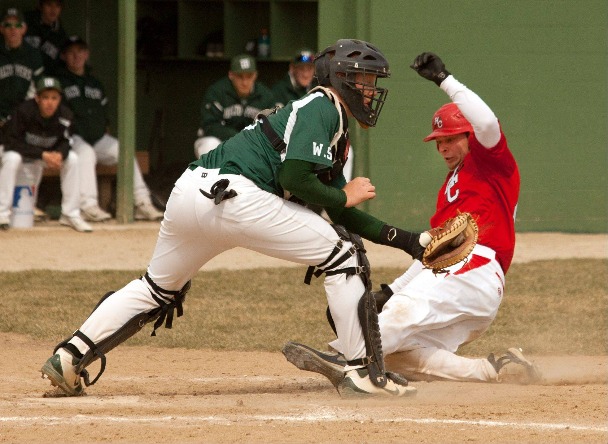 Glenbard West catcher Will Simoneit tags out Hinsdale Central's Jacob White during a 6-5 win .