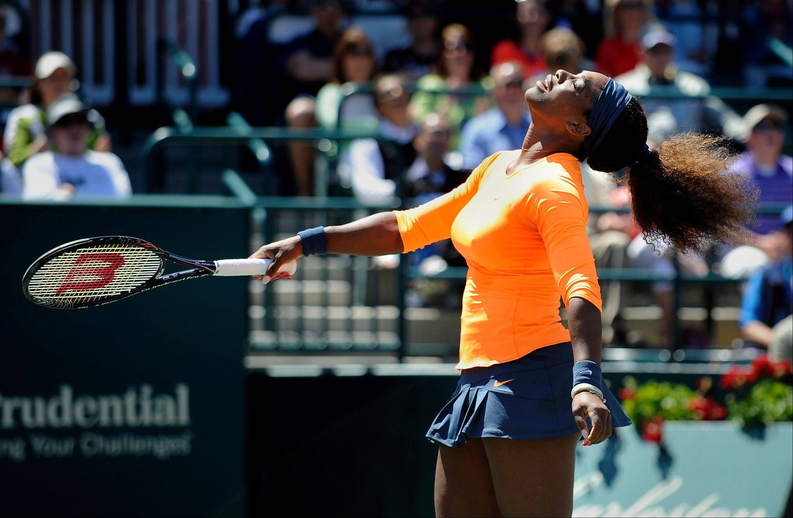 Serena Williams reacts after hitting a shot wide during a semifinal match against her sister Venus Williams at the Family Circle Cup tennis tournament in Charleston, S.C., Saturday, April 6, 2013. Serena won 6-1, 6-2.