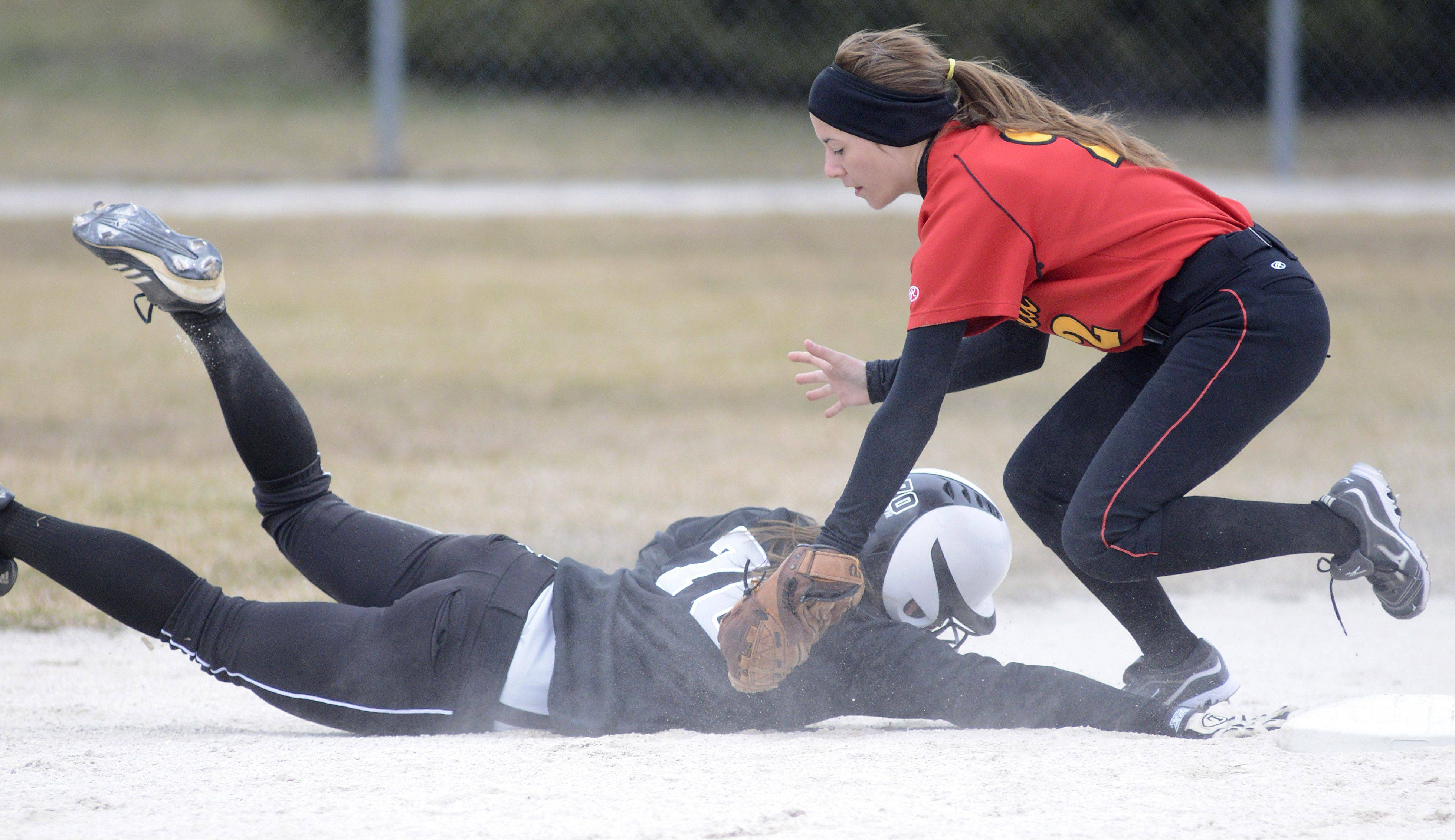 Kaneland's Lexi Roach is tagged out at second base by Batavia's Alex Scaccia in the first inning on Saturday, April 6.