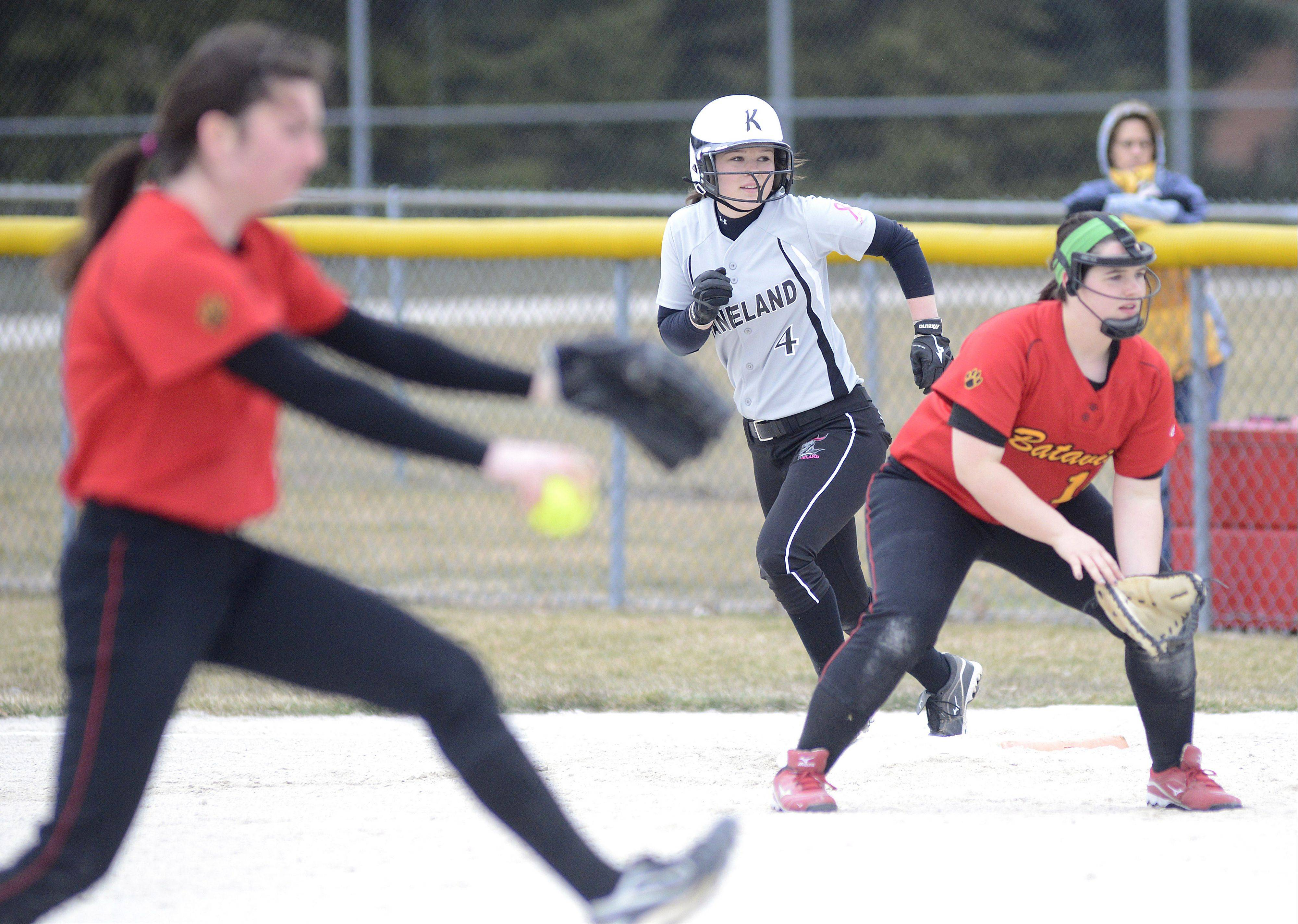 Kaneland's Allyson O'Herron leads off first base from Batavia's Natalie Offutt as Nicole Peercy pitches in the first inning on Saturday, April 6.
